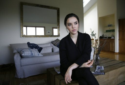 In this Feb. 21, 2017, photo, Erin Schrode poses at her home in Mill Valley, Calif. Less than a week before the election for her long-shot congressional campaign, Schrode woke up in her northern California home, rolled over in bed and reflexively checked her cellphone. The 25-year-old activist burst into tears when she found a barrage of anti-Semitic emails.
