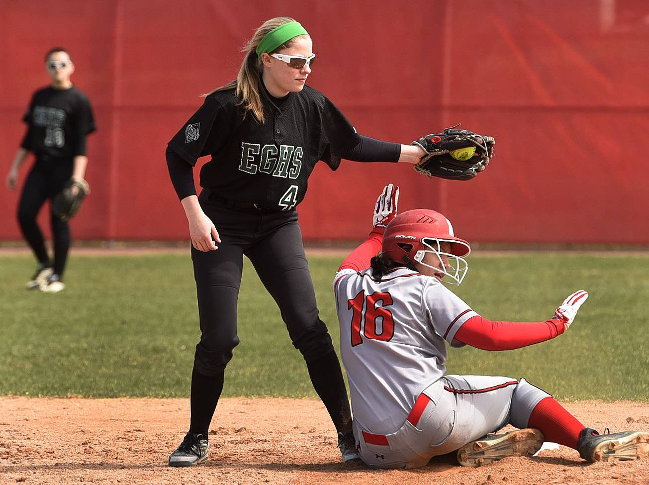 Mundelein's Kendall Klatt slides safely under the tag of Elk Grove's Keely Cronin while stealing during softball at Barrington's Fields of Dreams.