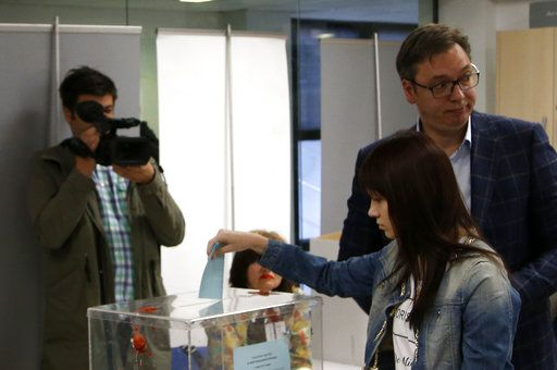 Current Serbian Prime Minister and presidential candidate Aleksandar Vucic, right, casts his ballot with his daughter Milica at a polling station, in Belgrade, Serbia, Sunday, April 2, 2017. Around 6.7 million voters in Serbia choose a new president in an election Sunday that will test the popularity of the dominant, populist prime minister, Aleksandar Vucic, against 10 beleaguered candidates from the fragmented opposition.