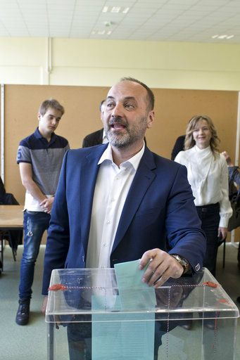 Sasa Jankovic, a Serbian presidential candidate, casts his ballot for the presidential elections at a polling station in Belgrade, Serbia, Sunday, April 2, 2017. Voters in Serbia are casting ballots in a presidential election seen as a test of public support for populist Prime Minister Aleksandar Vucic and his autocratic rule.