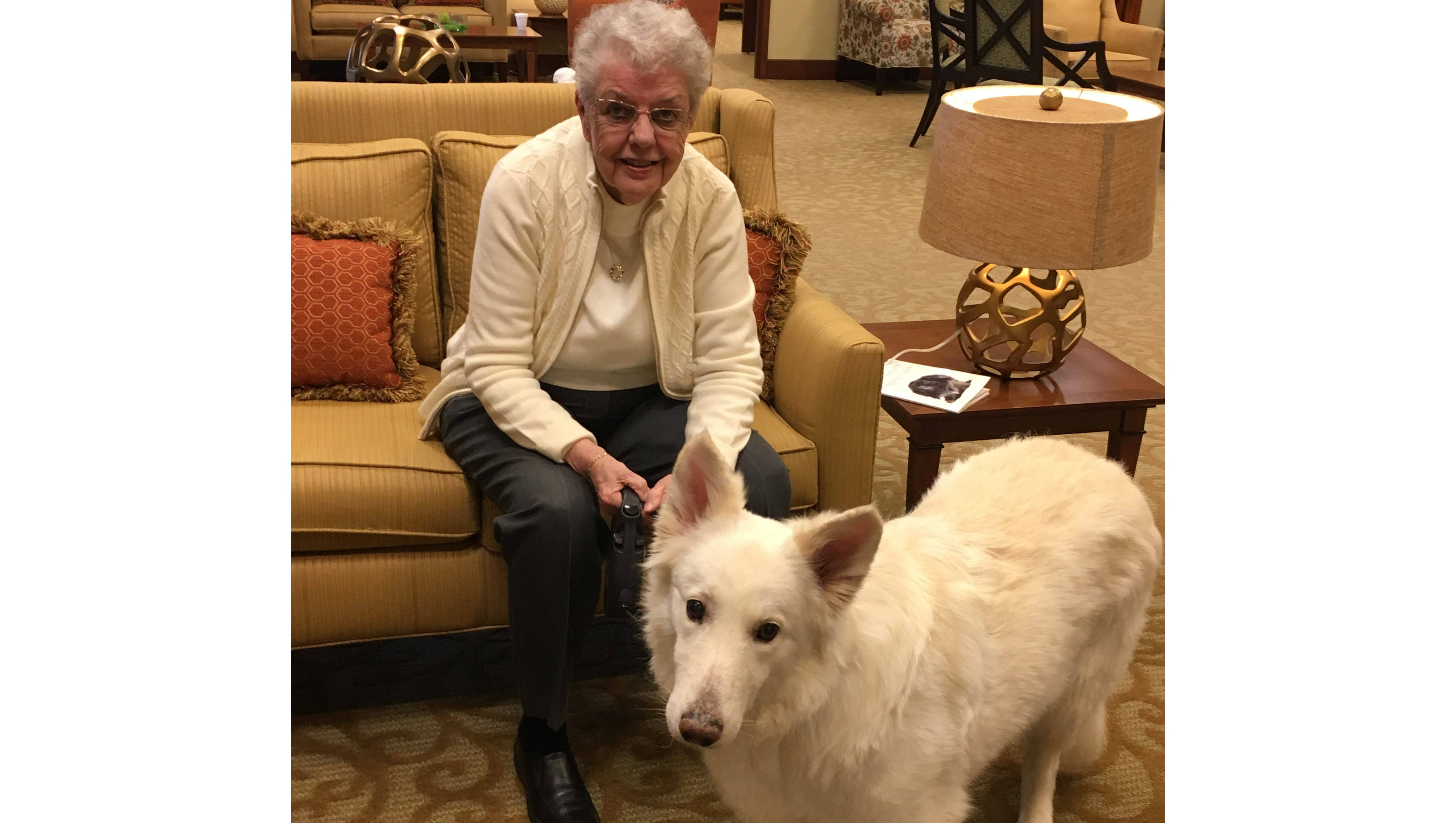 Monarch Landing resident Jeri Miller and Lucy, her much beloved 80-pound white shepherd