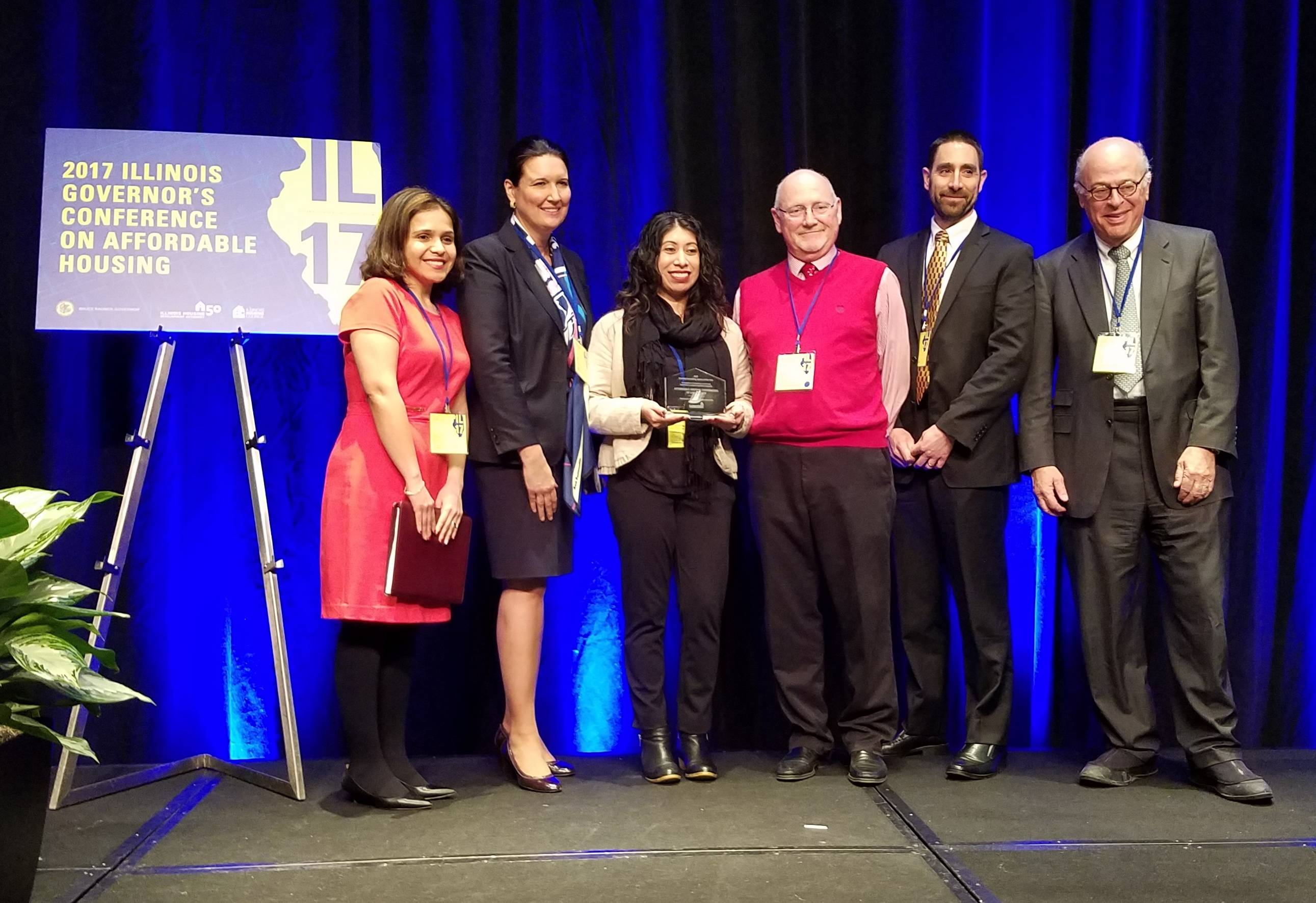 Affordable Housing Corporation of Lake County was presented the 2017 IL Housing Counseling Agency of the Year Award by the Illinois Housing Development Authority. From left: IHDA Assistant Director of Community Affairs Monica Enriquez, IHDA Director of Community Affairs Nicki Pecori Fioretti, AHC Director of Housing Services Laura Olvera, AHC Director of Real Estate Services Mike Mader, AHC Executive Director Rob Anthony, and IHDA Board Chair King Harris at the Hyatt Regency in Chicago