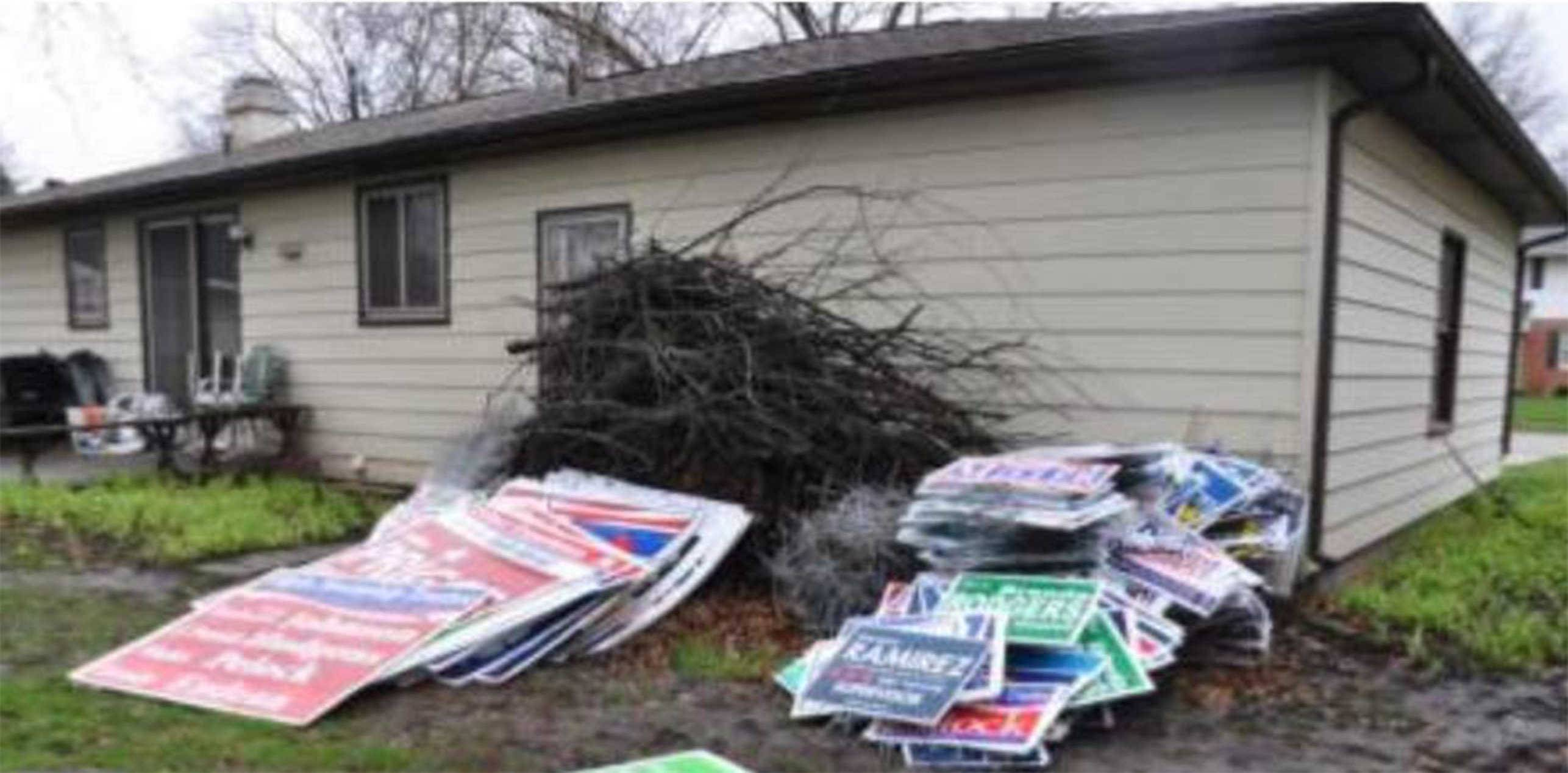 Authorities say they found hundreds of stolen campaign signs at Randy Hopp's home in Elgin.