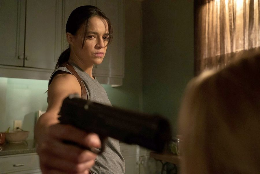 "Tomboy (Michelle Rodriguez) used to be a macho hitman until an insane surgeon turned him into a woman during Walter Hill's action thriller ""The Assignment."""