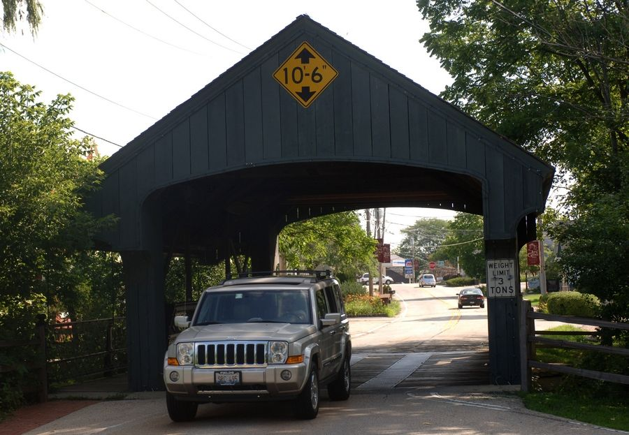 The covered bridge leading into downtown Long Grove has been placed on a list of the Most Endangered Historic Places in Illinois. It comes as village officials grapple with a decision of whether to restore and preserve the one-lane bridge in its current form or build a modern, two-lane replacement.