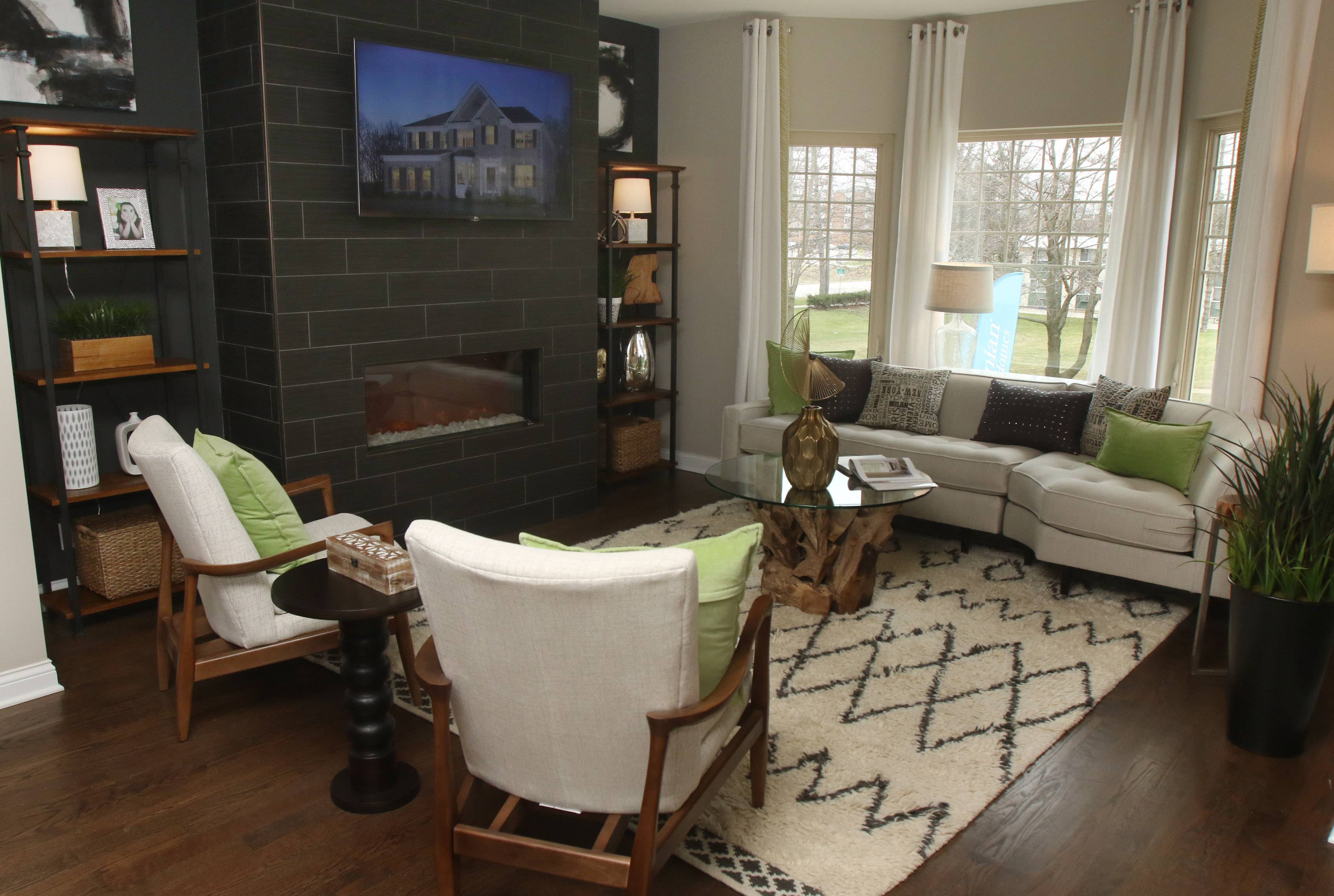 Living room in the Erie model mixes contemporary items with more rustic pieces.