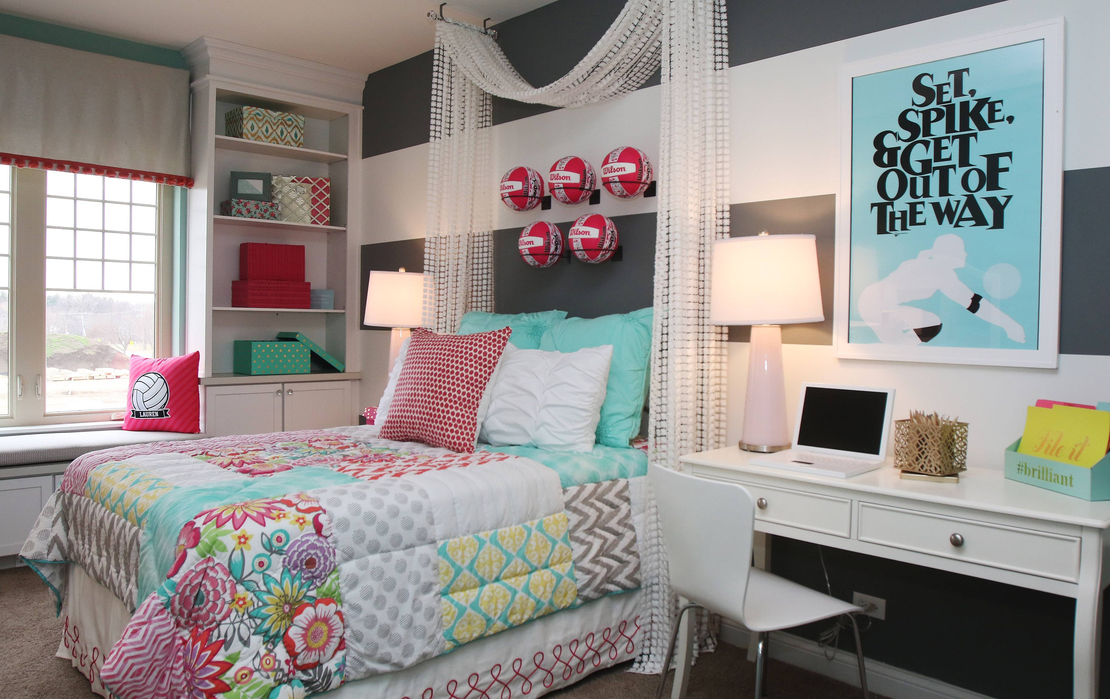 This girls bedroom in the Ontario model shows a canopy bed and pink and teal color scheme.