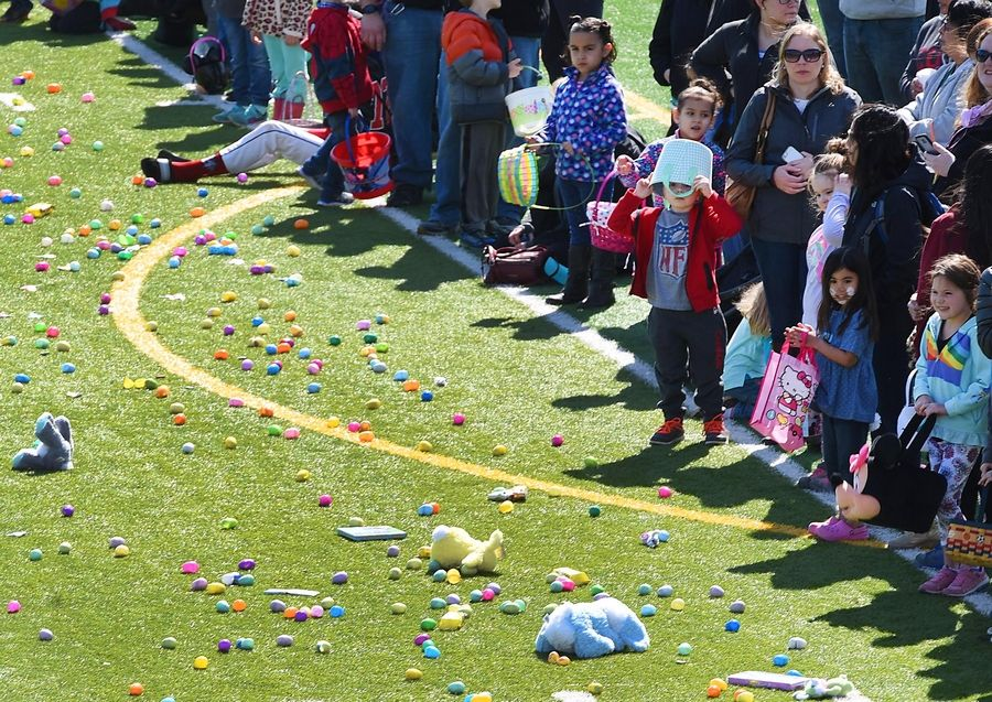 A child wears a bucket on his head as he waits to charge onto the field to collect prizes Saturday at the Mooseheart Easter egg hunt in North Aurora.