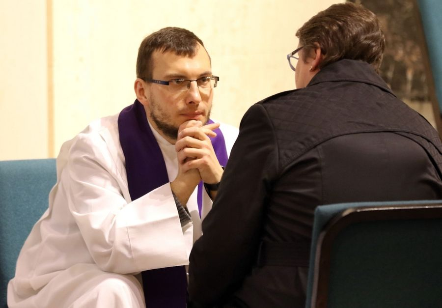 The Rev. Michal Lewon of St. Colette Church in Rolling Meadows take a confession during a reconciliation Mass at Our Lady of the Wayside Catholic Church in Arlington Heights on Monday.