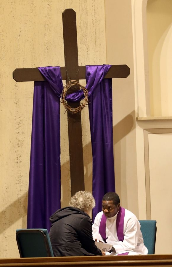 The Rev. John Bosco of Our Lady of the Wayside takes a confession during a reconciliation Mass at Our Lady of the Wayside Catholic Church in Arlington Heights on Monday.