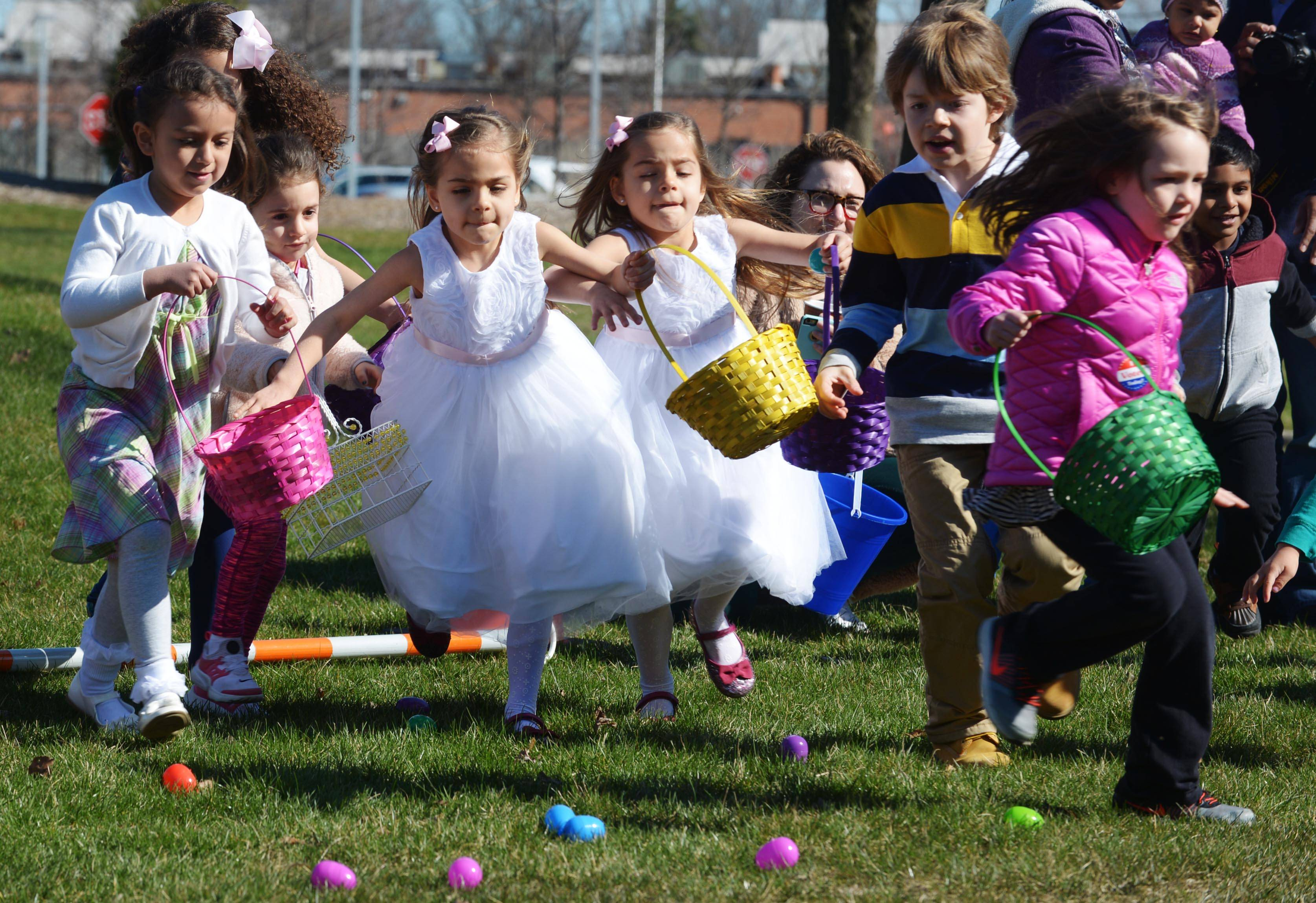 Children rush to gather Easter eggs during the Hoppin' Holiday Hunt at the Sullivan Community Center in Vernon Hills Saturday.