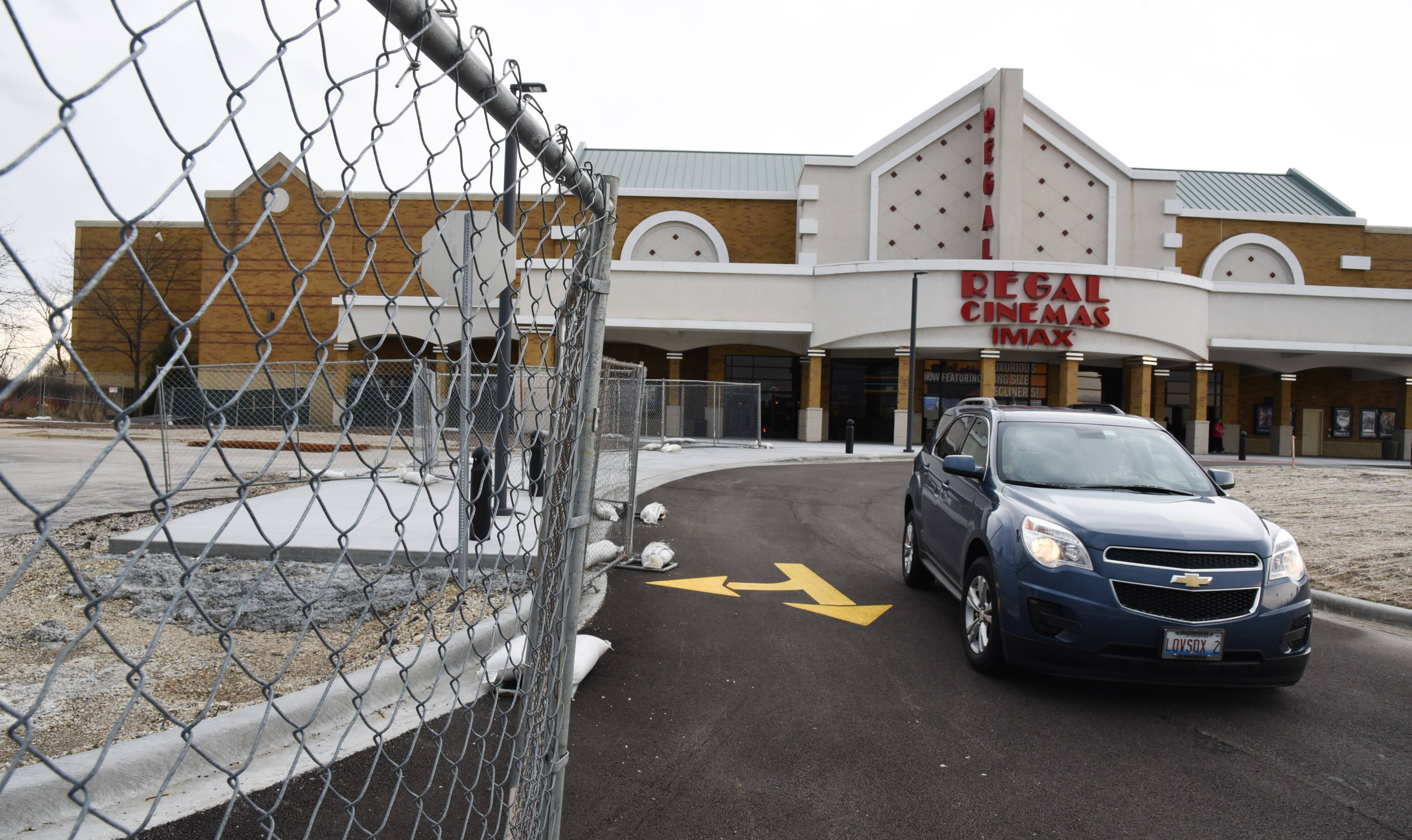 Some of the land near the Regal Cinemas movie house in Lincolnshire is fenced off for the construction of an apartment complex. Village officials are considering hiring a consultant to develop a plan for the businesses and homes along the town's Milwaukee Avenue corridor.