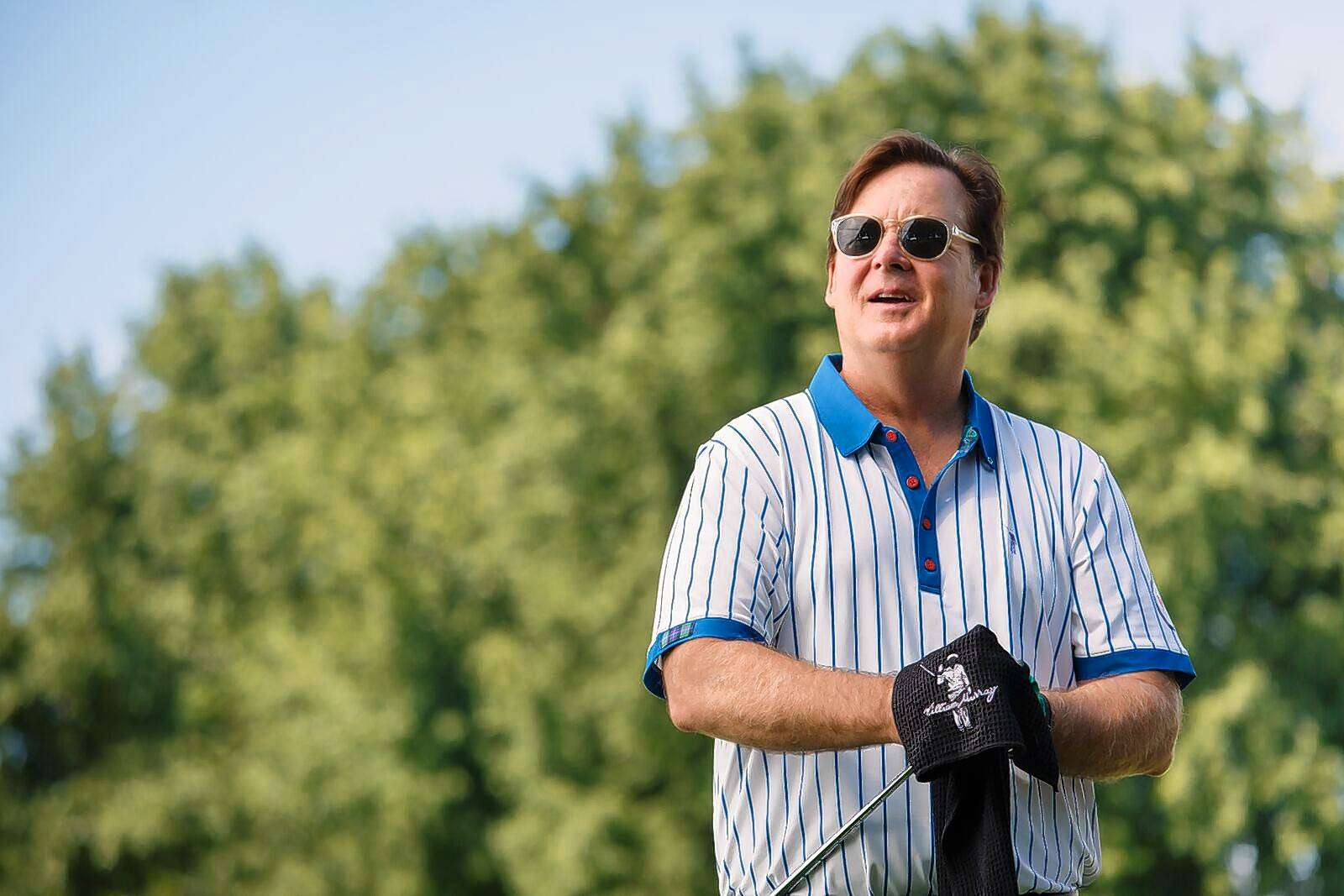 While he doesn't ooze the coolness of his big brother, Bill Murray, Joel Murray says he stays cool in this shirt from the William Murray Golf clothing line run by the six Murray brothers. This pinstriped shirt reflects Chicago Cubs passion.