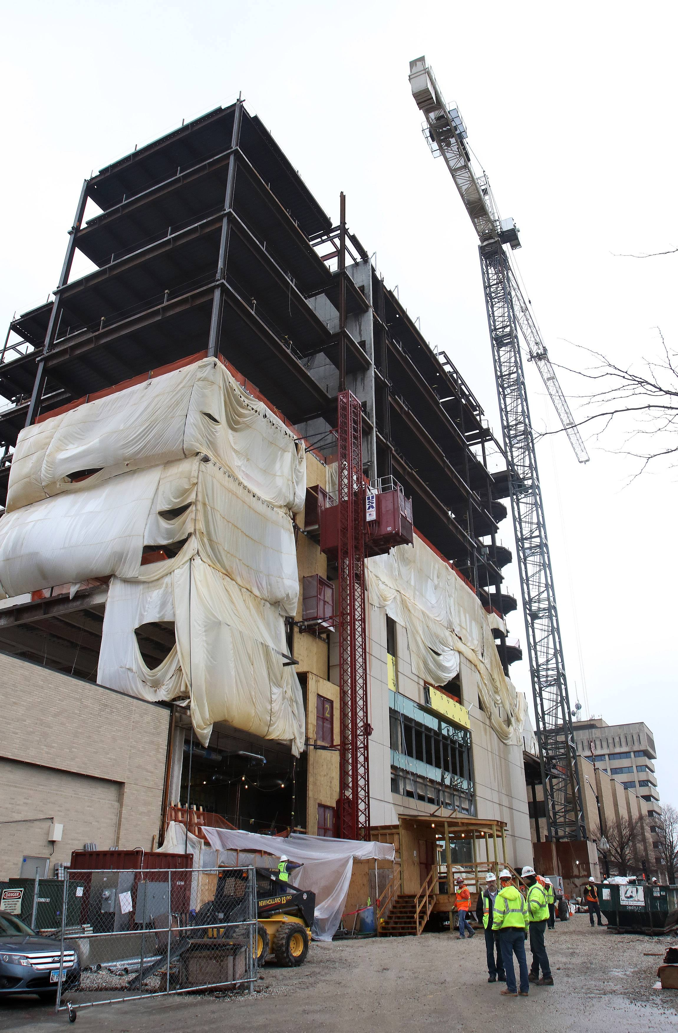 "Work is continuing on the construction of the $112 million Lake County courthouse expansion in Waukegan. A ""Topping Out"" ceremony was held on Tuesday and the beam will be raised to the top of the building Wednesday."