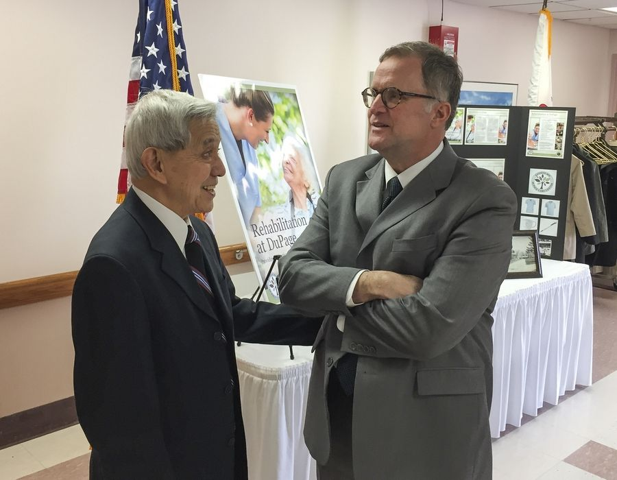 Kenneth Moy chats with DuPage County Board Chairman Dan Cronin Tuesday before a renaming dedication ceremony for the DuPage Care Center in Wheaton.