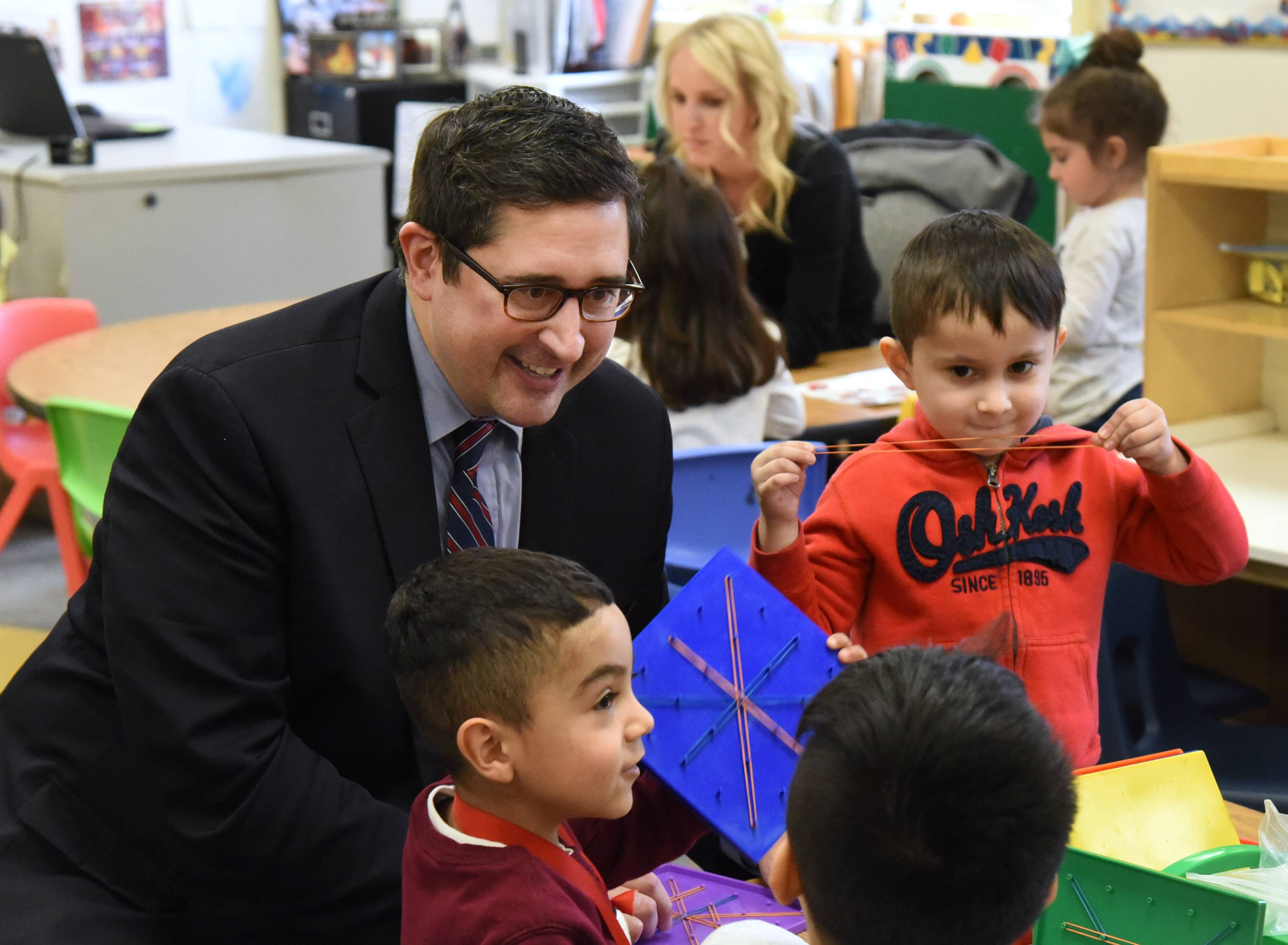 Democratic state Rep. Sam Yingling of Grayslake, left, talks to students in the preschool classroom of Kali Skiles, rear, during Tuesday's visit to the Round Lake Early Education Center.