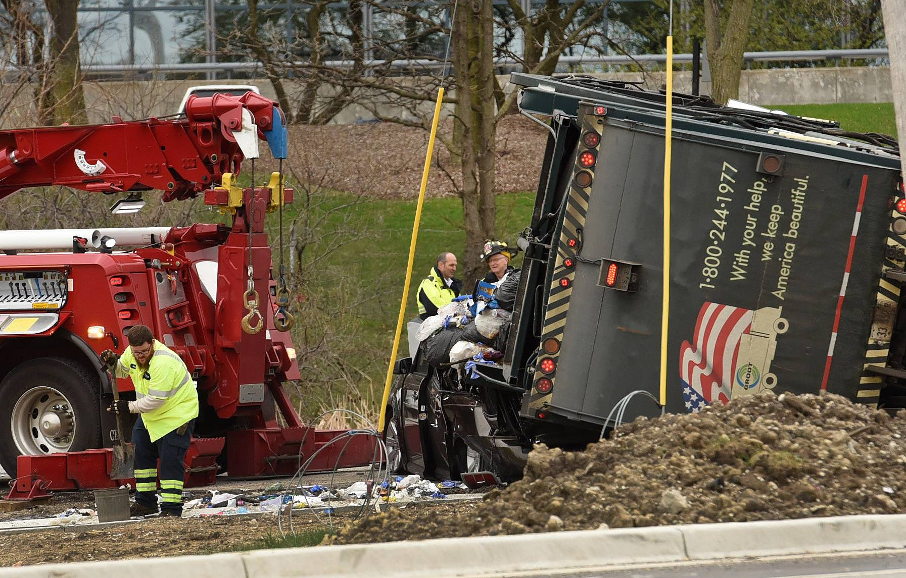A garbage truck flipped onto its side and onto a car near the southbound ramp of Route 53 on Higgins Road in Schaumburg Tuesday afternoon.