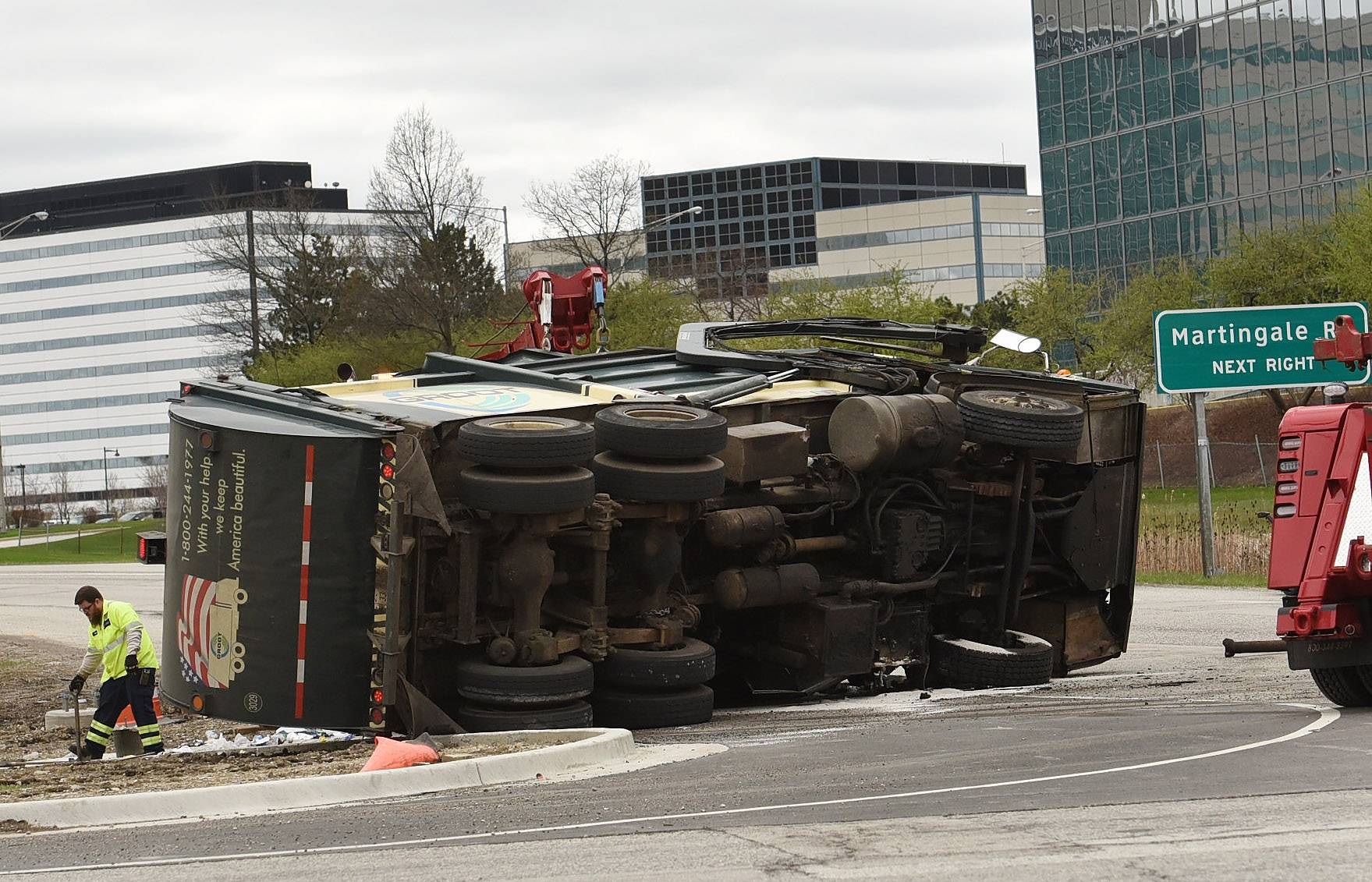 A garbage truck flipped onto its side and onto a car near the southbound ramp of Route 53 on Higgins Road in Schaumburg Tuesday afternoon. The truck's driver was cited for driving with defective brakes and failure to reduce speed to avoid an accident.