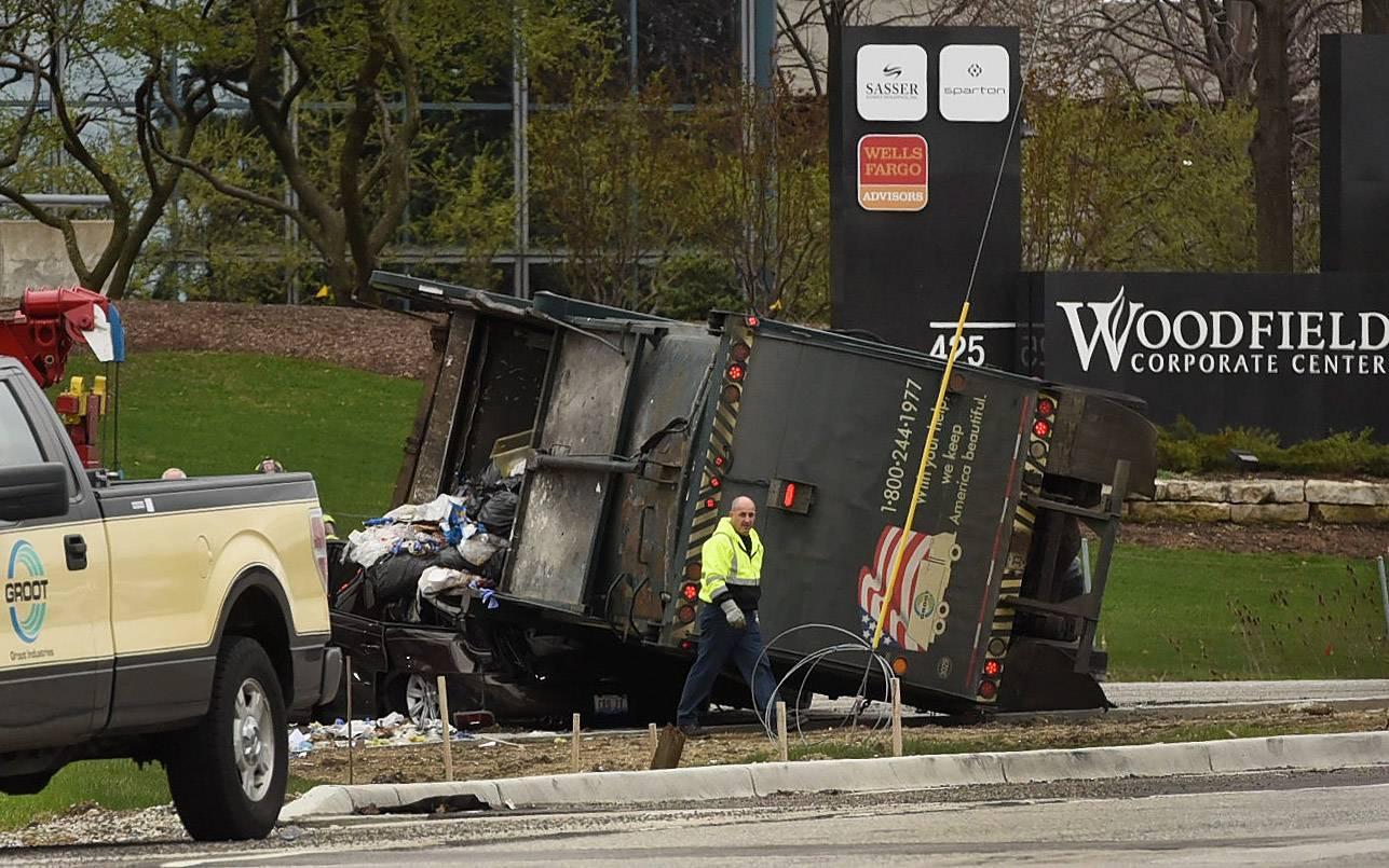A garbage truck flipped onto its side and onto a car near the southbound ramp of Route 53 on Higgins Road in Schaumburg Tuesday afternoon. The truck landed partly on another vehicle. Both drivers suffered minor injuries.