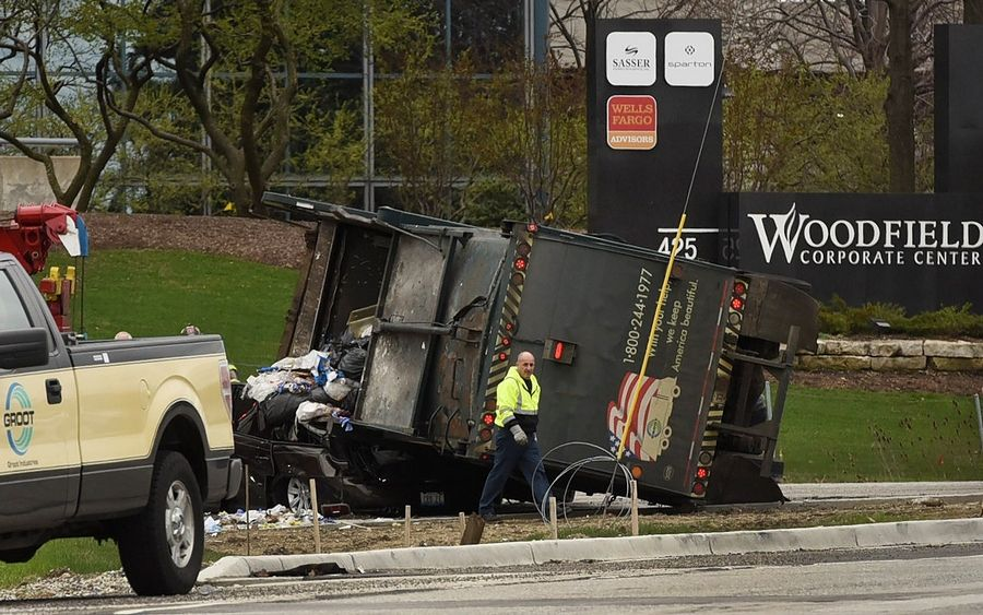 Garbage truck driver cited for rollover onto car south of