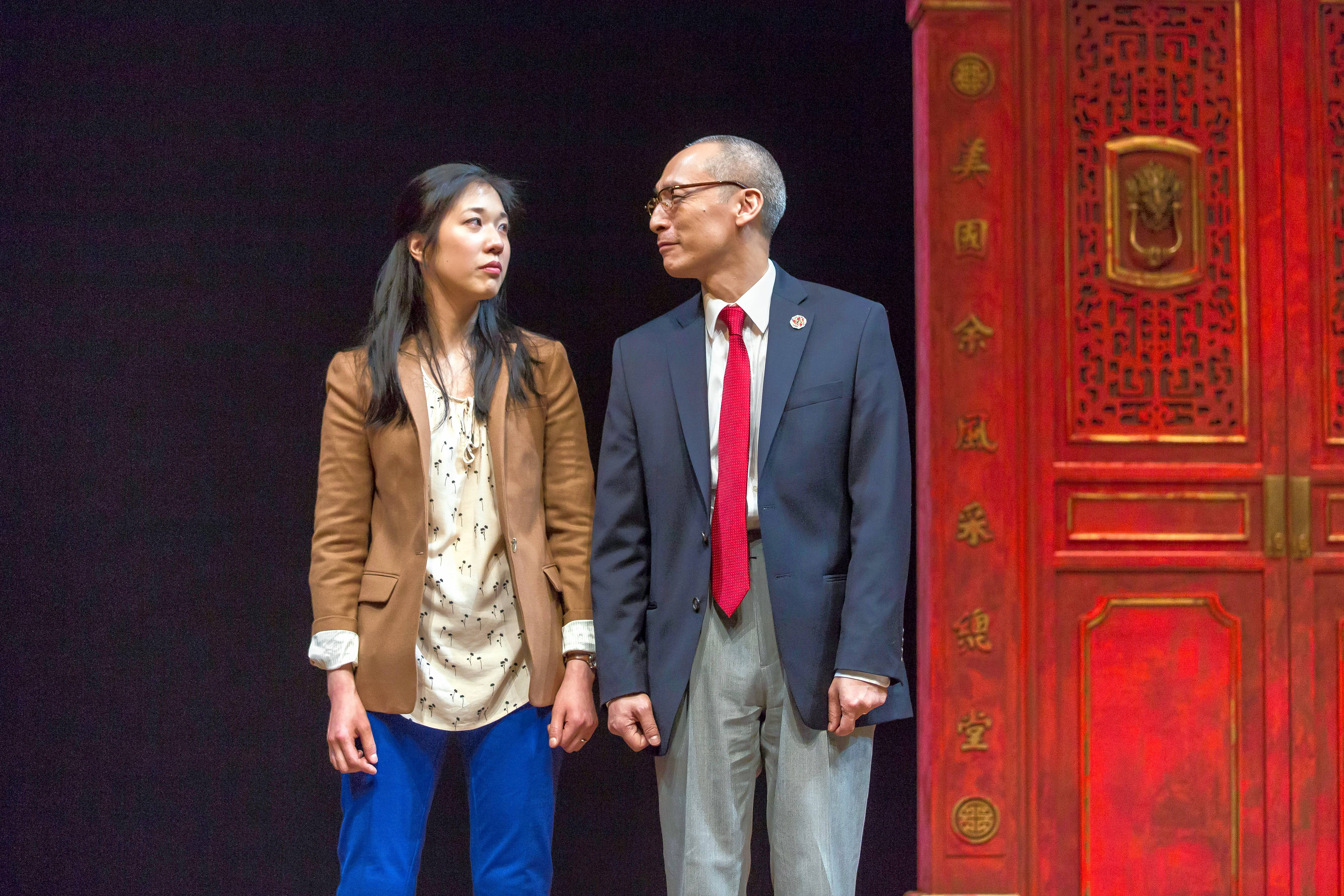 "Lauren (Stephenie Soohyun Park) and her father, Larry Yee (Francis Jue), don't always see eye-to-eye in the world premiere of Lauren Yee's ""King of the Yees"" at the Goodman Theatre in Chicago."