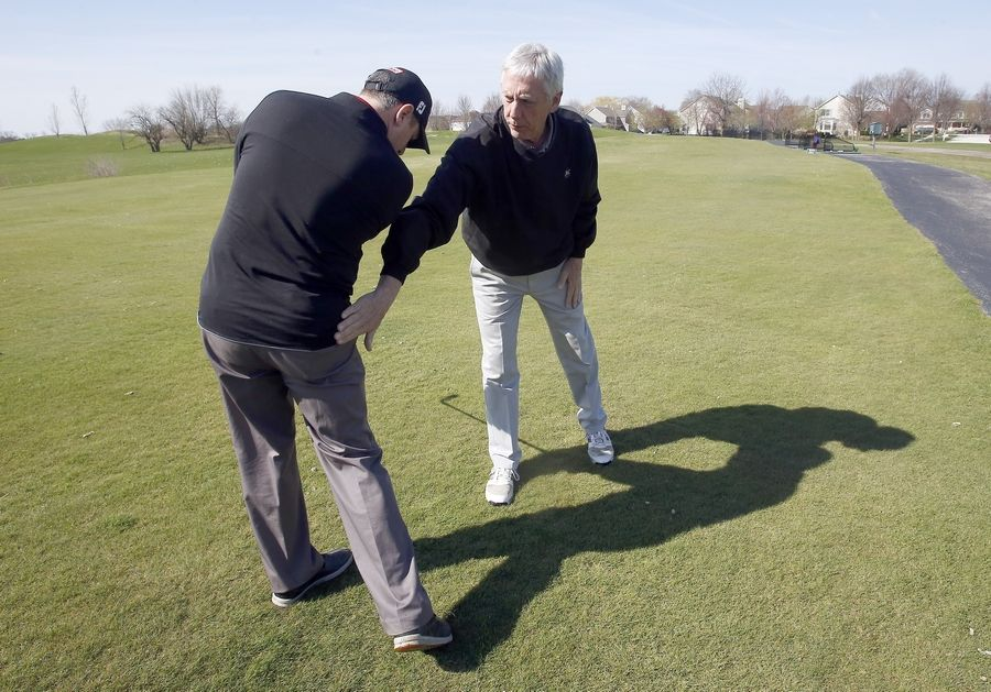 Rick Bell, an instructor at Mill Creek Golf Club in Geneva, will speak about options for hip pain and how to manage the pain when playing golf. Here he demonstrates on Ryan Buckland, Mill Creek's general manager and director of golf.