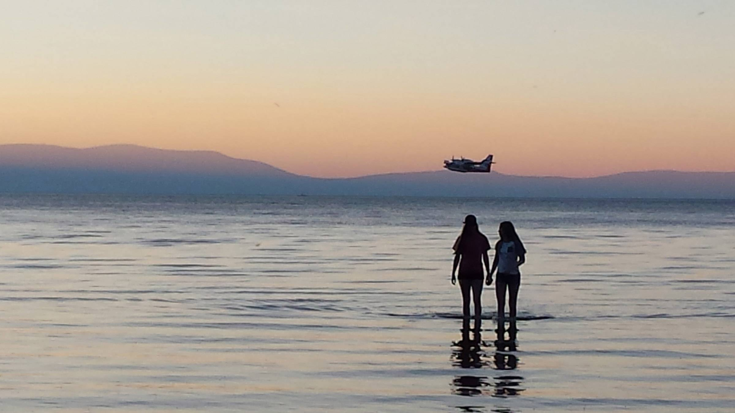 Two sisters, Claire and Erin, wade into Lake Tahoe, Calif. at sundown in August 2016.