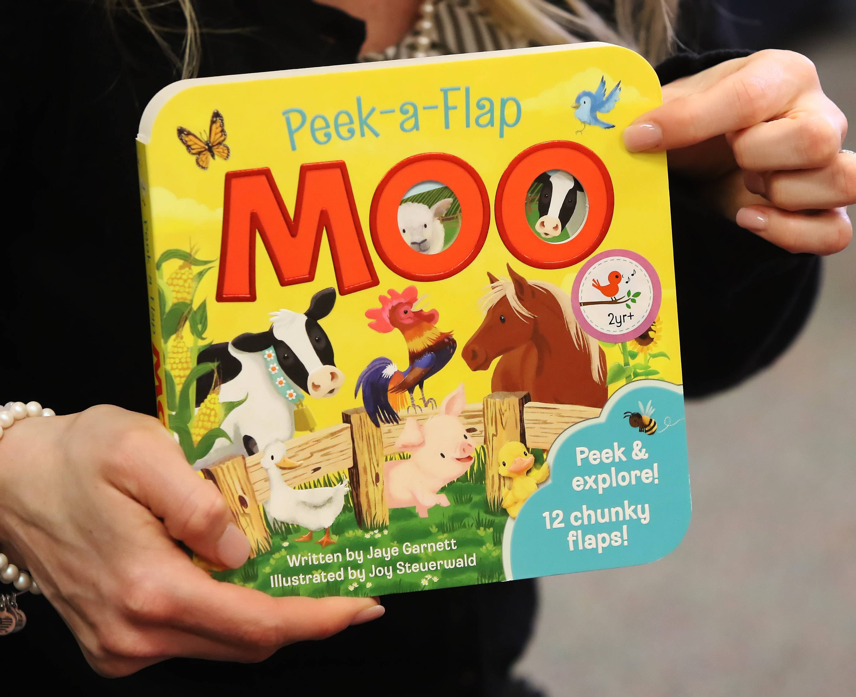 "Preschool teacher Kali Skiles reads ""Peek-A-Flap Moo"" for her students Tuesday at the Round Lake Early Childhood Center."