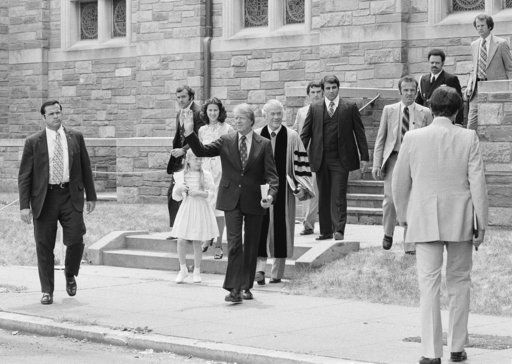 FILE - In this June 9, 1977 file photo, President Jimmy Carter waves as he departs the First Baptist Church in Washington with daughter Amy and daughter-in-law Caron Carter. The Rev. Charles Trentham, pastor of the church, is at right. At Washington churches, presidents have long been seated in the pews. Bill and Hillary Clinton favored a Methodist church. Jimmy Carter taught Baptist Sunday School. And Barack Obama dropped in at an Episcopal church next to the White House. But as Easter Sunday approaches, President Donald Trump has not attended a church service in the Capitol since the worship events during his inauguration weekend.