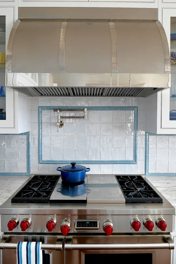 Designer Erin Paige Pitts worked with RangeCraft to style a striking stainless-steel and pewter range hood for the Todorov family's kitchen in Bishopville, Maryland.