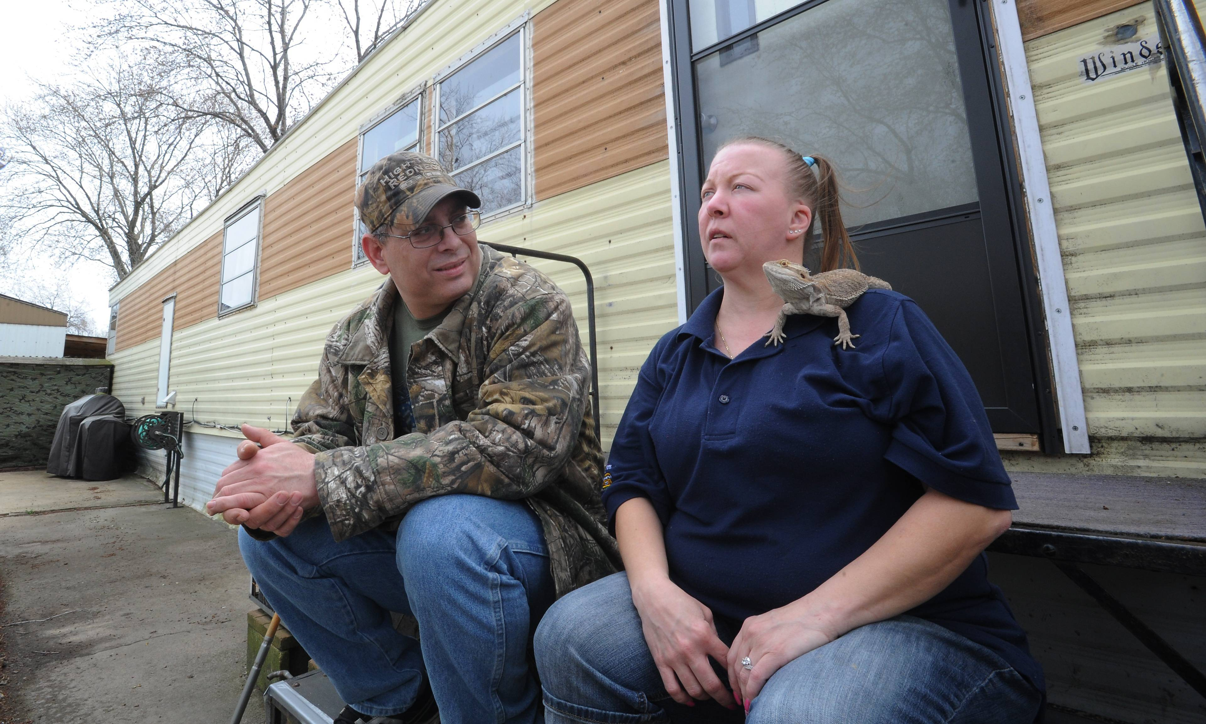 The Oasis Mobile Home Park in Des Plaines has no storm shelter on the property. Clinton and Laurie Brookshire said they would stay put with their bearded dragon, Spike, in their mobile home.