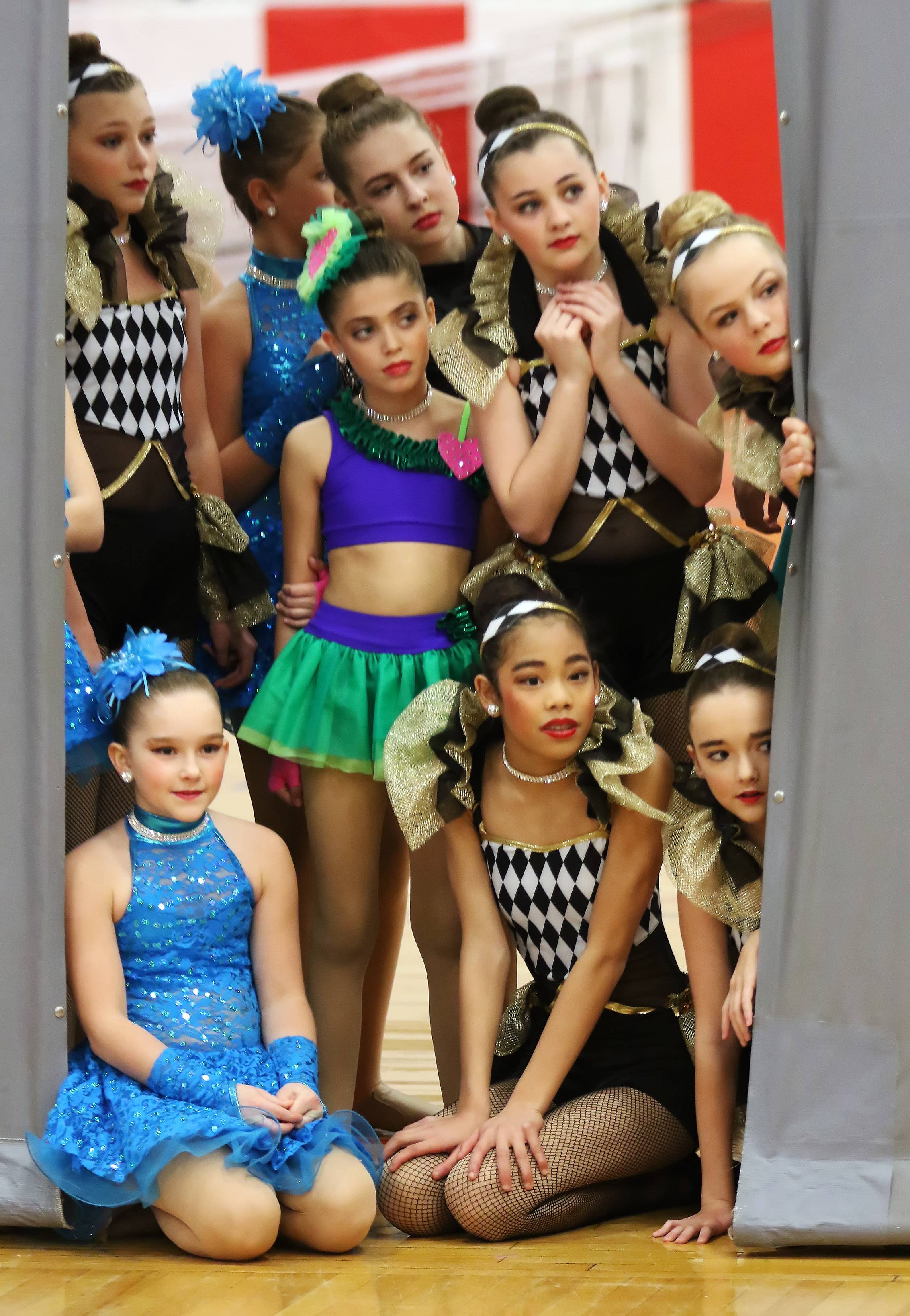 Members of Bataille Academie of the Danse watch fellow dancers perform during the 4th Annual Barrington Family Expo on Sunday at Barrington High School. The exposition featured 90 booths of area businesses and community resources.