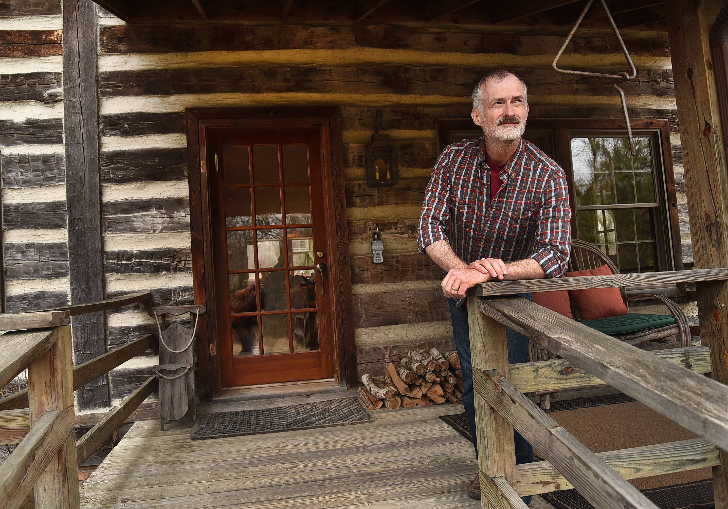 Kevin Sherman in the gathering room of his log cabin in Barrington Hills.