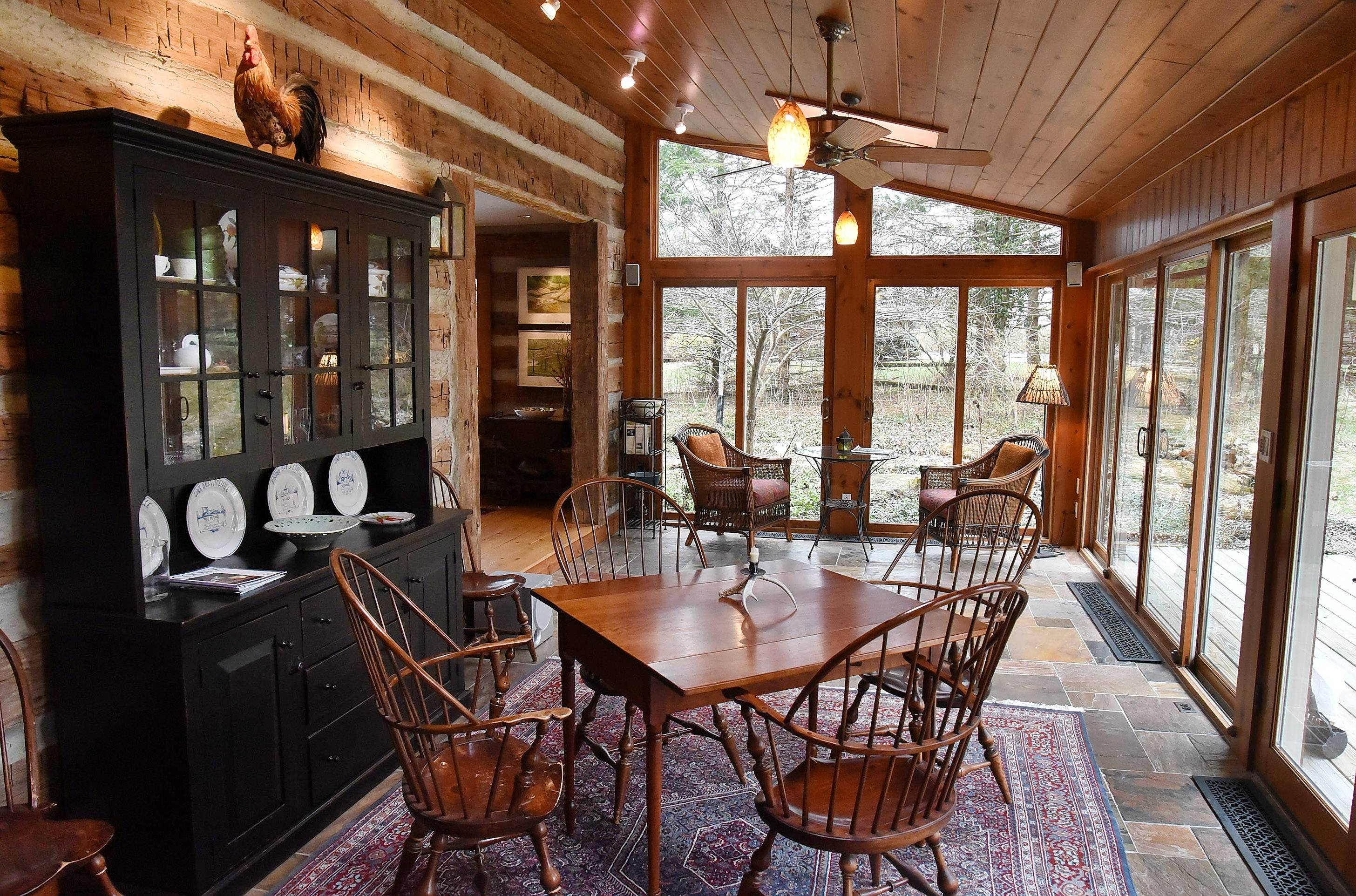 Sunroom of Kevin and Laurie Sherman's log cabin in Barrington Hills.