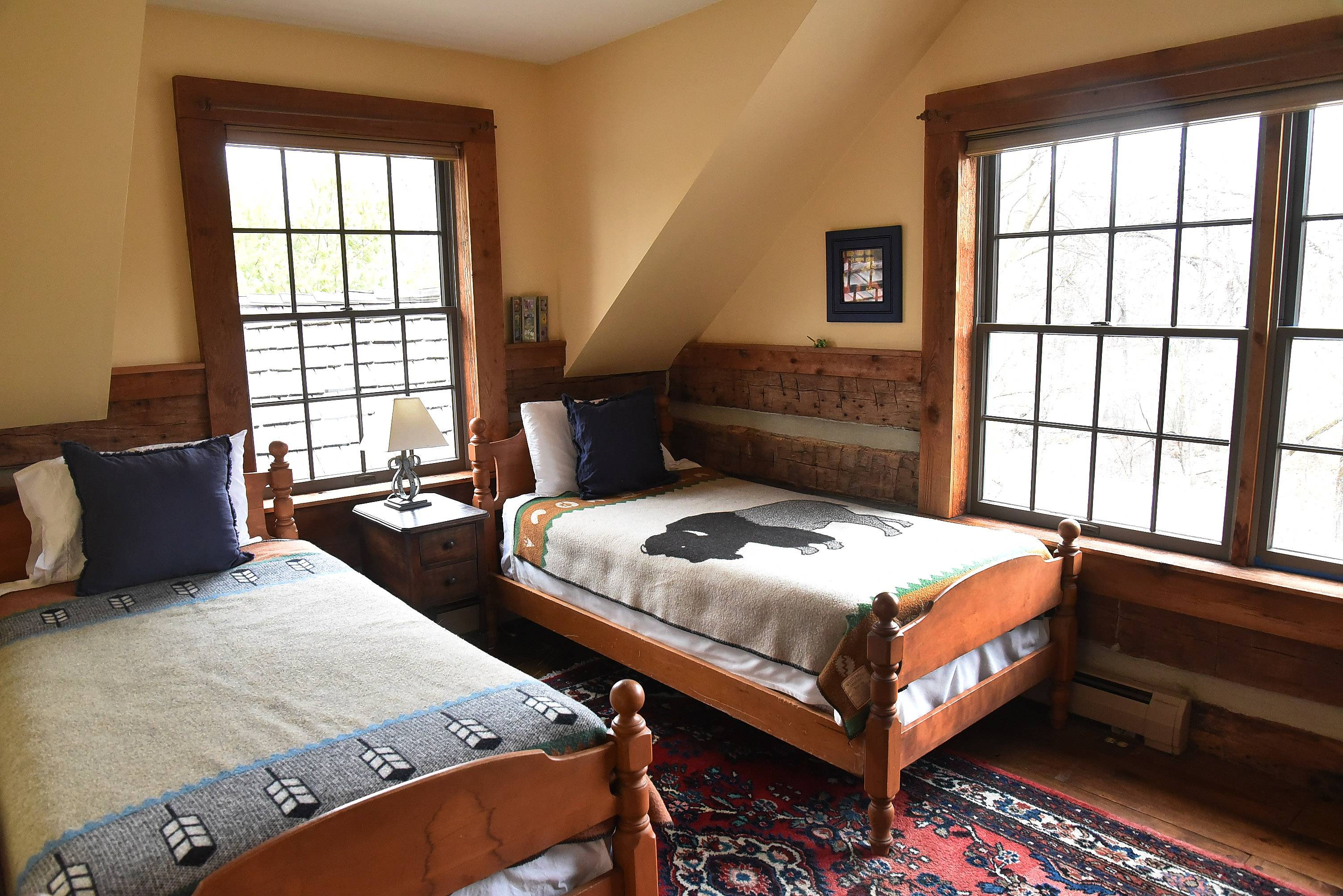 One of the bedrooms in Kevin and Laurie Sherman's log cabin in Barrington Hills.