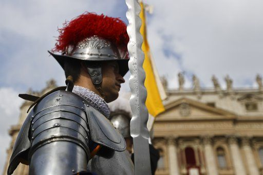 Swiss Guards stand in front of St. Peter's Basilica at the Vatican, Sunday, April 16, 2017