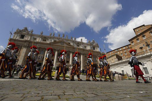 Swiss guards march in St. Peter's Square at the Vatican, Sunday, April 16, 2017. Pope Francis celebrated Easter Sunday Mass in St. Peter's Square, decorated with colorful spring flowers.