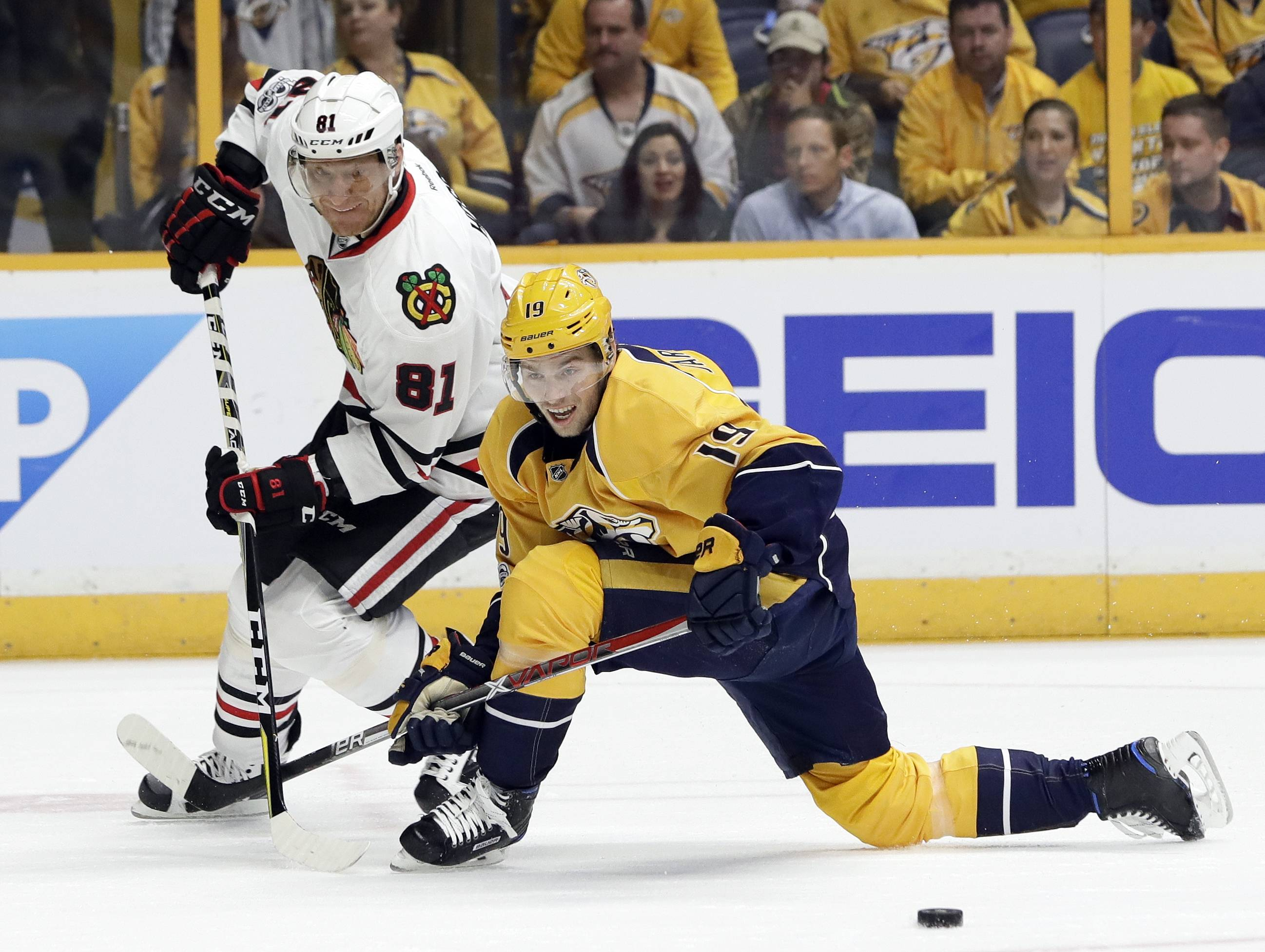 Chicago Blackhawks right wing Marian Hossa (81), of Slovakia, passes the puck past Nashville Predators center Calle Jarnkrok (19), of Sweden, during the first period in Game 3 of a first-round NHL hockey playoff series, Monday, April 17, 2017, in Nashville, Tenn.