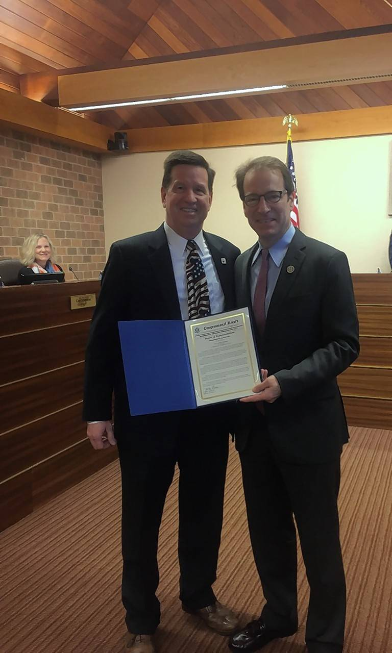 U.S. Rep. Peter Roskam, right, and Burr Ridge Mayor Mickey Straub at last week's village board meeting. Straub traveled to 50 states in 50 days to recite the Gettysburg Address at each state's capitol.