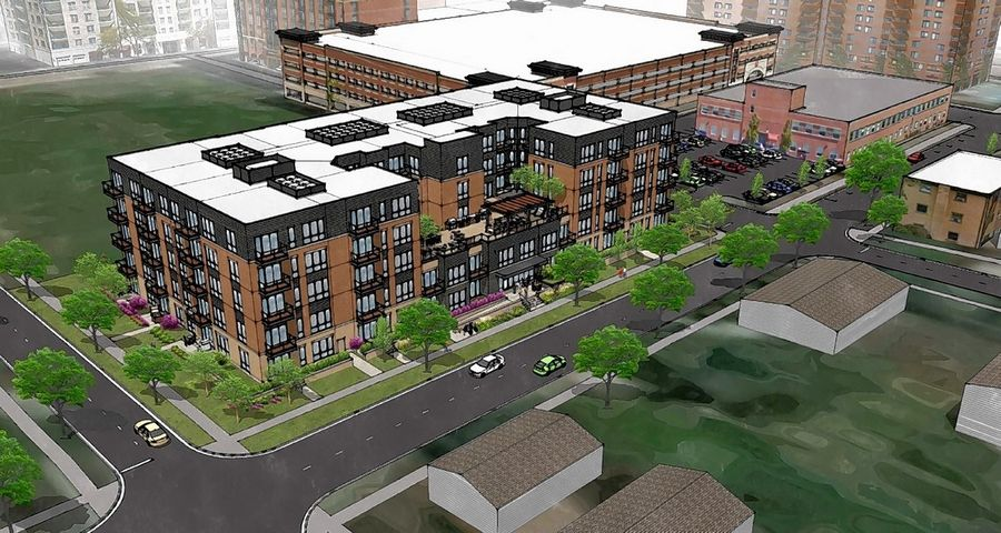 A proposed five-story apartment building on Sigwalt Street would be situated on the south side of a vacant block near downtown Arlington Heights.