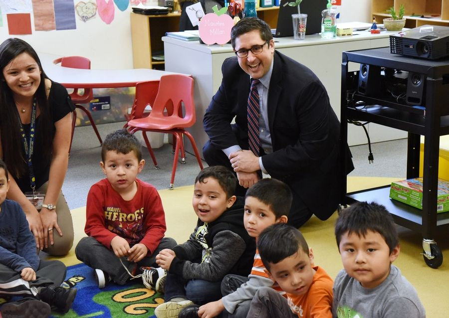 State Rep. Sam Yingling visits a bilingual class taught by Yuri Millan, left, during a stop at the Round Lake Early Education Center last week.