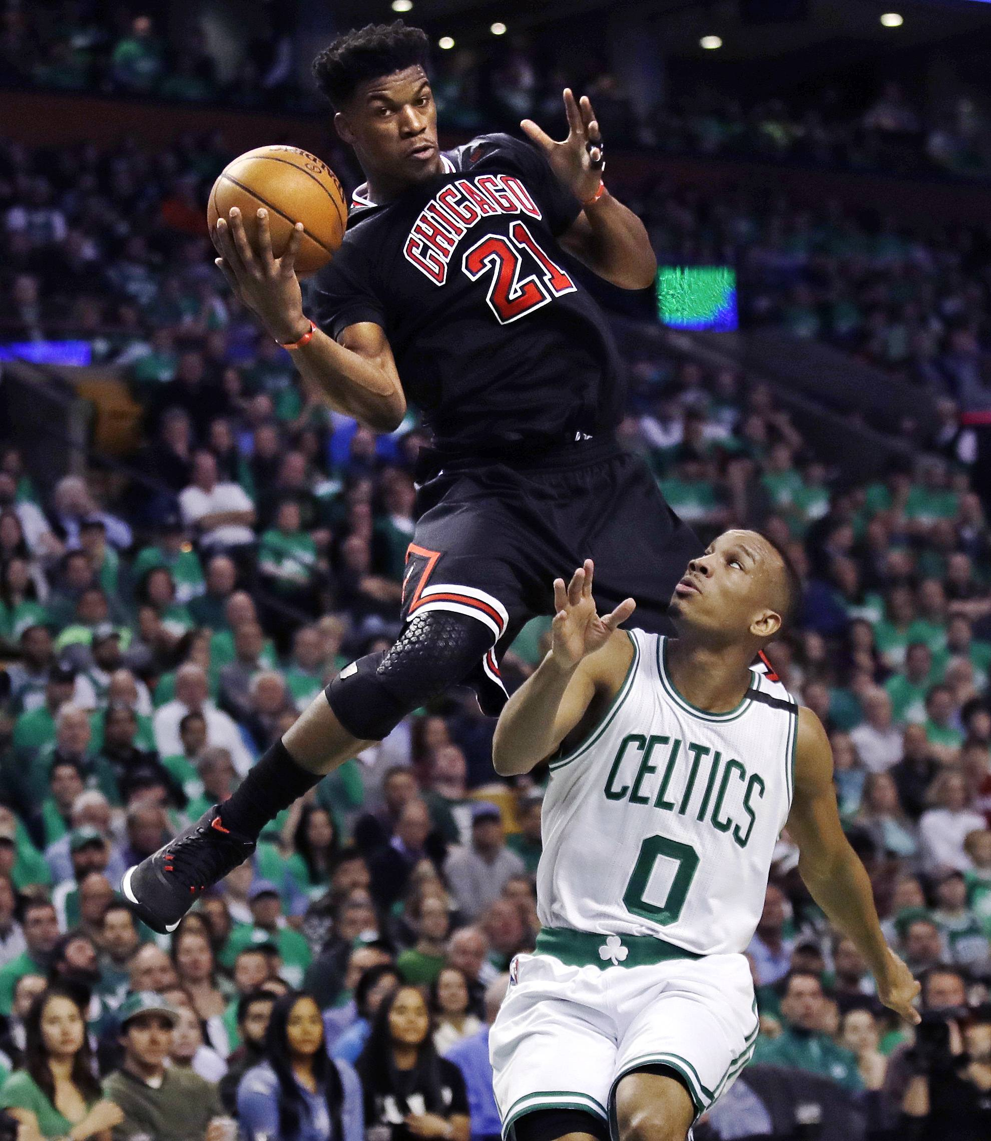 Chicago Bulls forward Jimmy Butler (21) catches a pass high above Chicago Bulls guard Isaiah Canaan (0) during the second quarter of a first-round NBA playoff basketball game in Boston, Tuesday, April 18, 2017.