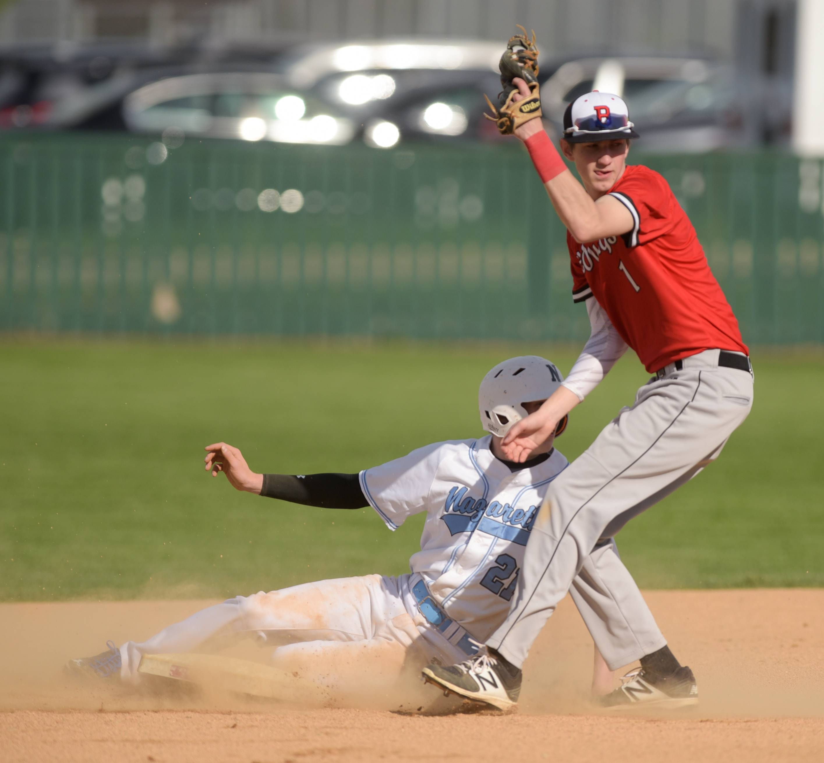 Benet Academy's Jack Schneider makes the out on Nazareth's Chancellor Roach during varsity baseball in Lisle, April 18, 2017.