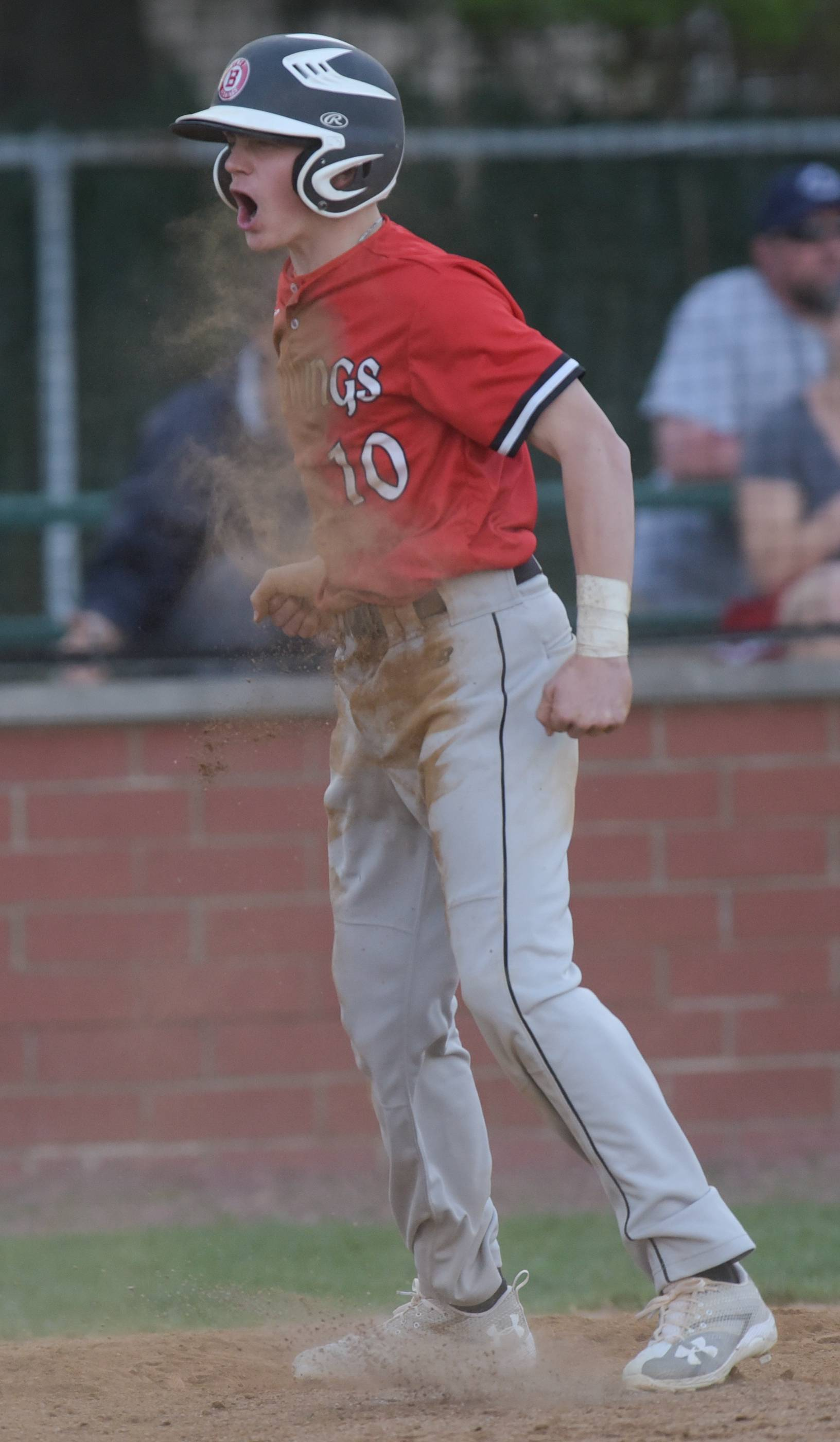 Benet Academy's Dolan Glasgow celebrates scoring the tying run in the 7th inning against Nazareth during varsity baseball in Lisle, April 18, 2017.