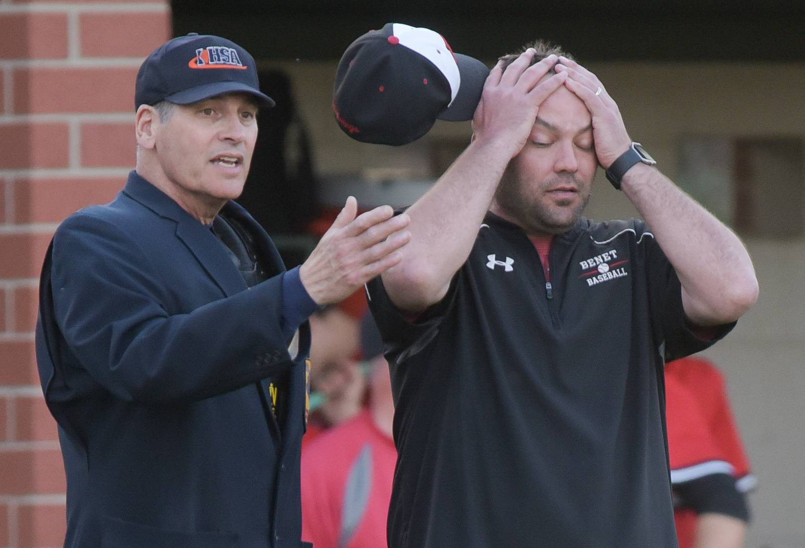 While arguing a call with the home plate umpire, Benet Academy's head coach Scott Lawler reaction sums up the  feelings Benet had toward the officiating during varsity baseball against Nazareth in Lisle, April 18, 2017.  The game ended in a 10-10 tie.