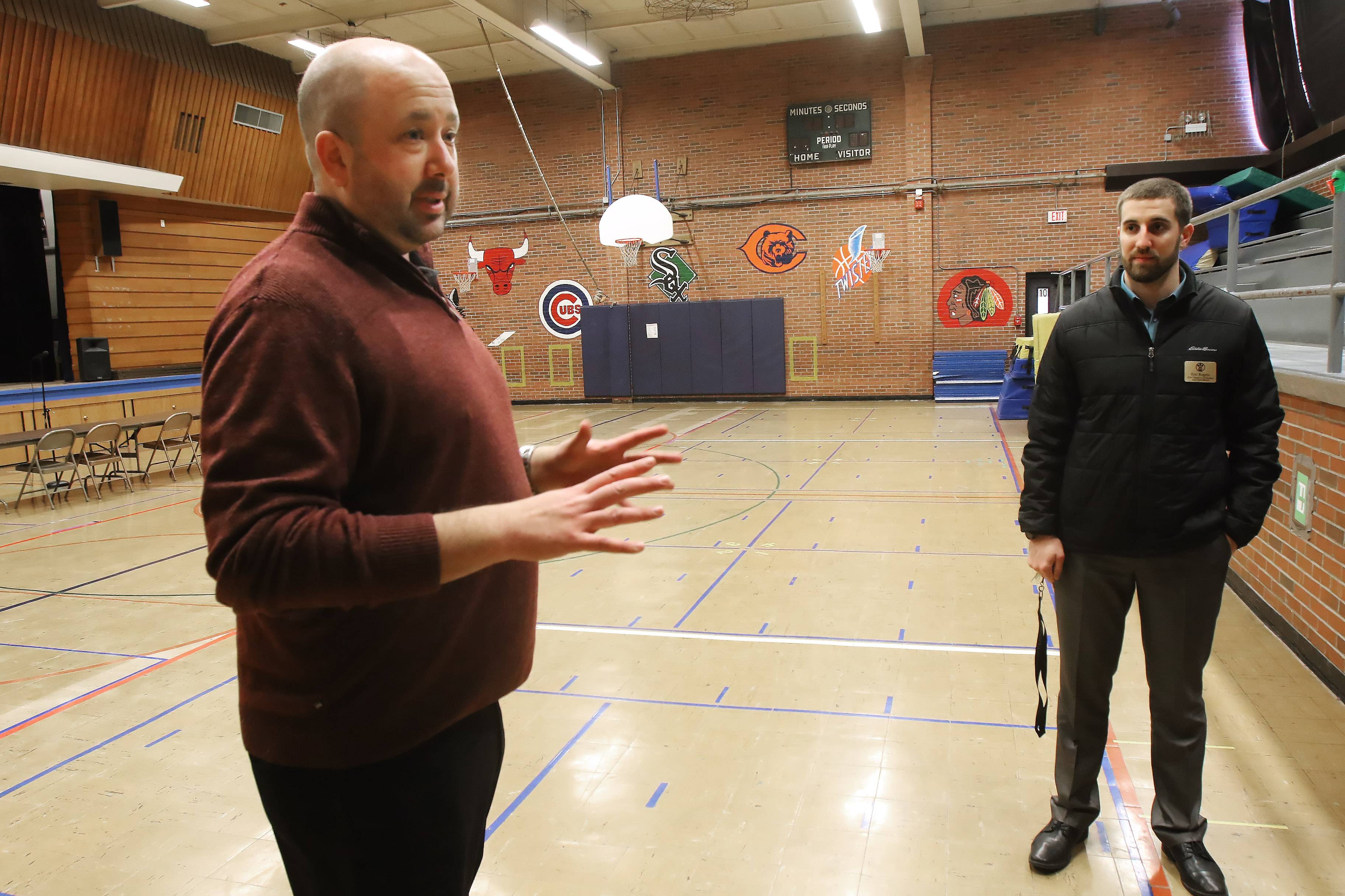 Principal Kurt Preble, left, and Eric Rogers, director of finance and operations for Diamond Lake District 76, discuss the need for a new gym at Diamond Lake School in Mundelein.