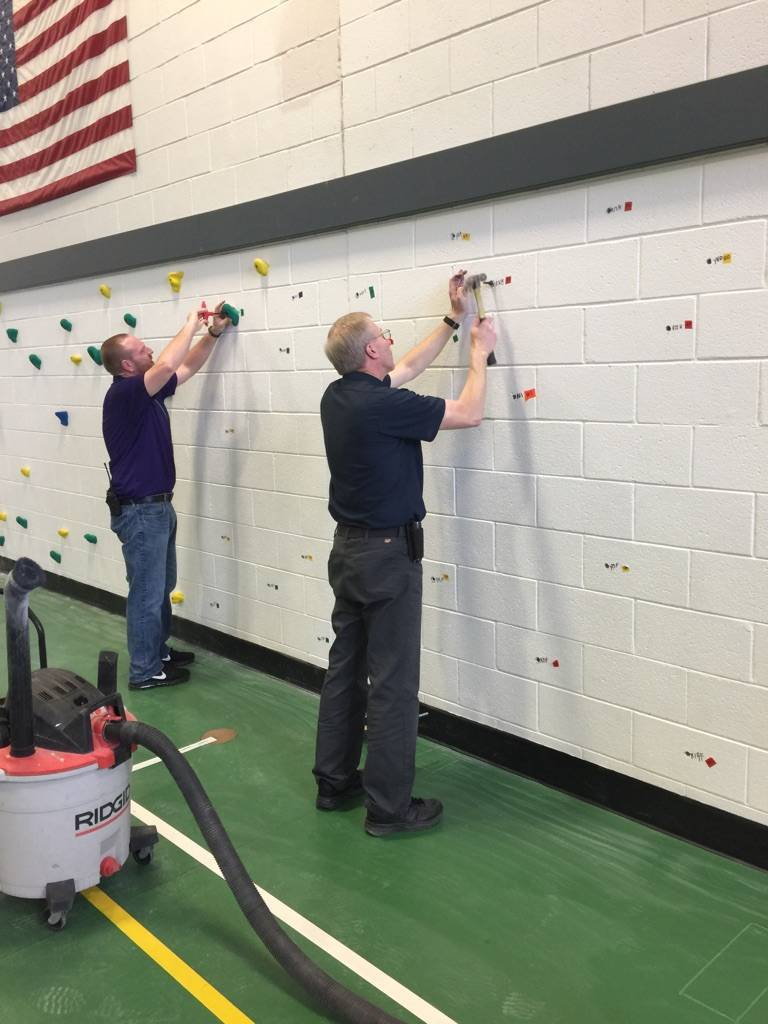 Grant helps Woodland Intermediate build climing wall