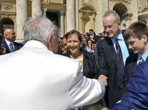 Pope Francis shakes hands Wednesday with TV host Bill O'Reilly, second from right, during his weekly general audience, at the Vatican.