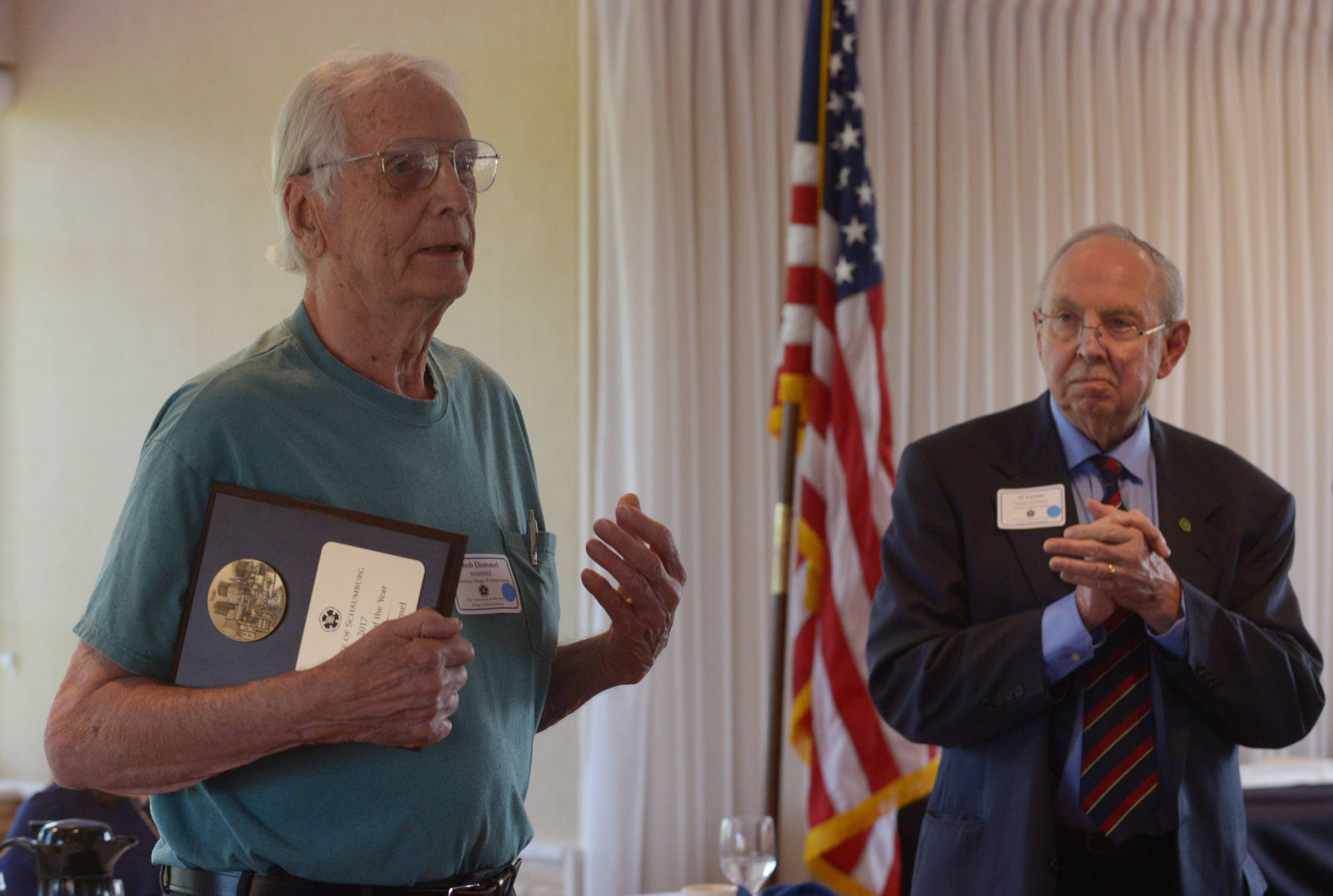 Adult Individual Award recipient Herb Demmel speaks as Mayor Al Larson stands beside him during Schaumburg's annual Volunteer of the Year Luncheon Thursday at Chandler's in Schaumburg.