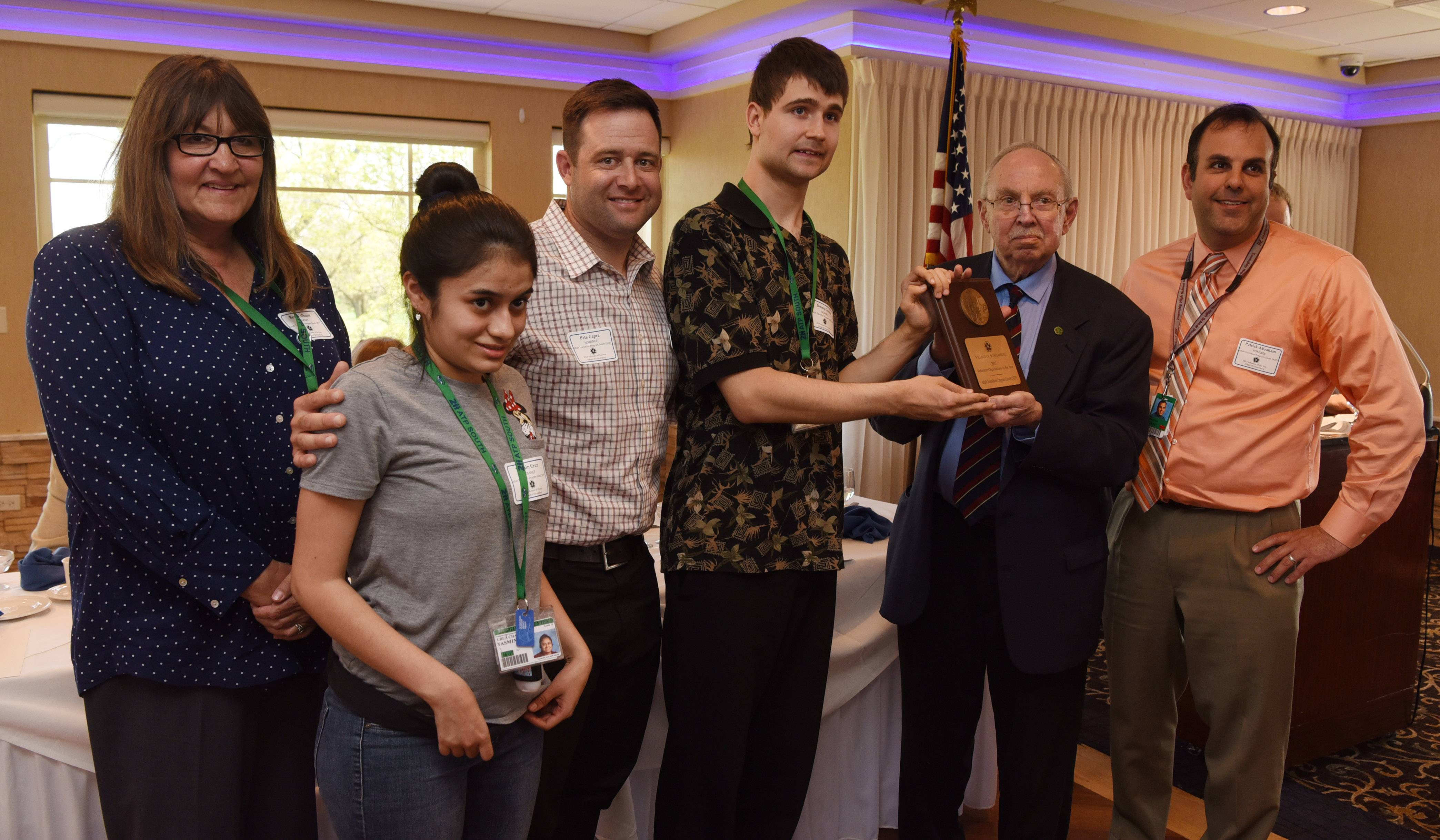 Schaumburg Mayor Al Larson, second from right, stands with the 2017 Organization Award recipients from Palatine-Schaumburg High School District 211's Adult Transition Program South, which includes, from left, Beth Culhane, Yasmin Cruz, Pete Capra, Tommy Gricius and Patrick Abraham during Schaumburg's annual Volunteer of the Year Luncheon Thursday at Chandler's in Schaumburg.
